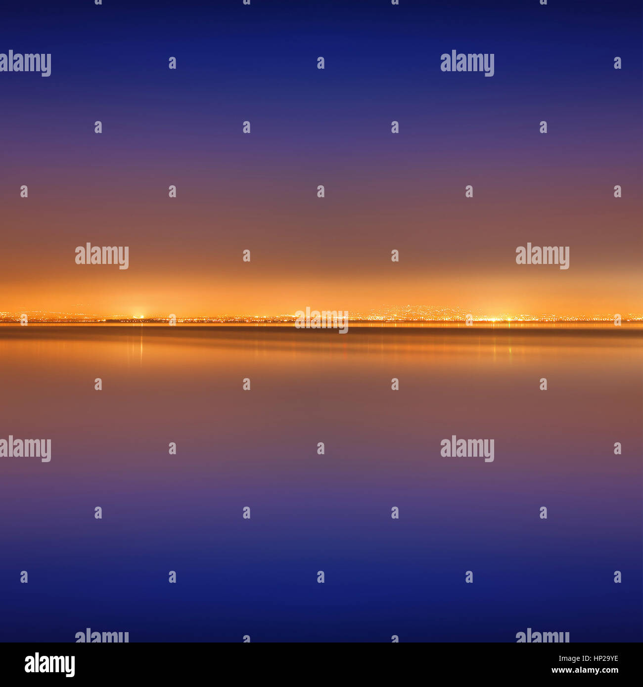 Golden city lights during the blue hour - Stock Image