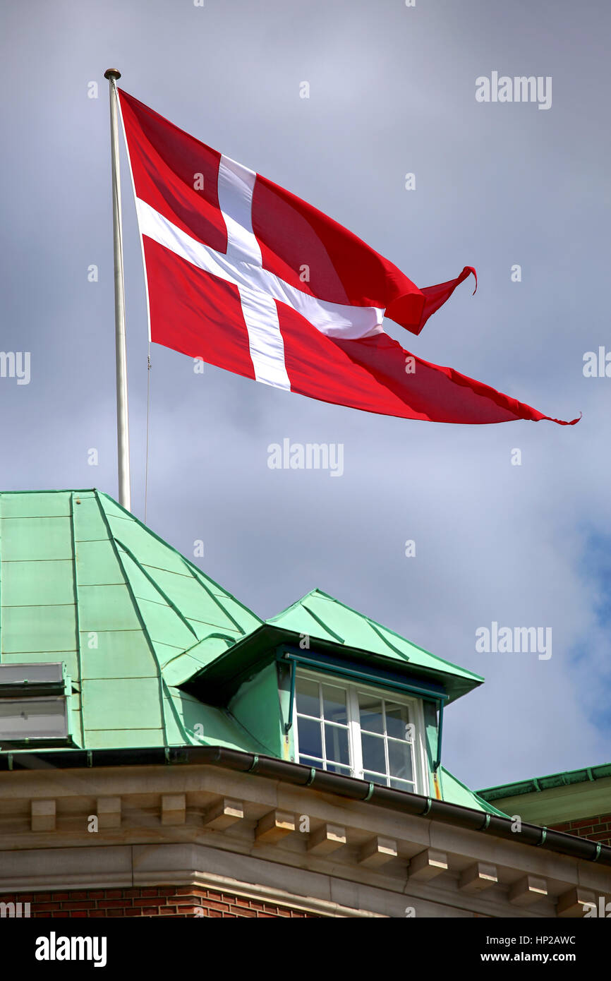 Waving Danish flag on the mast in Copenhagen, Denmark Stock Photo
