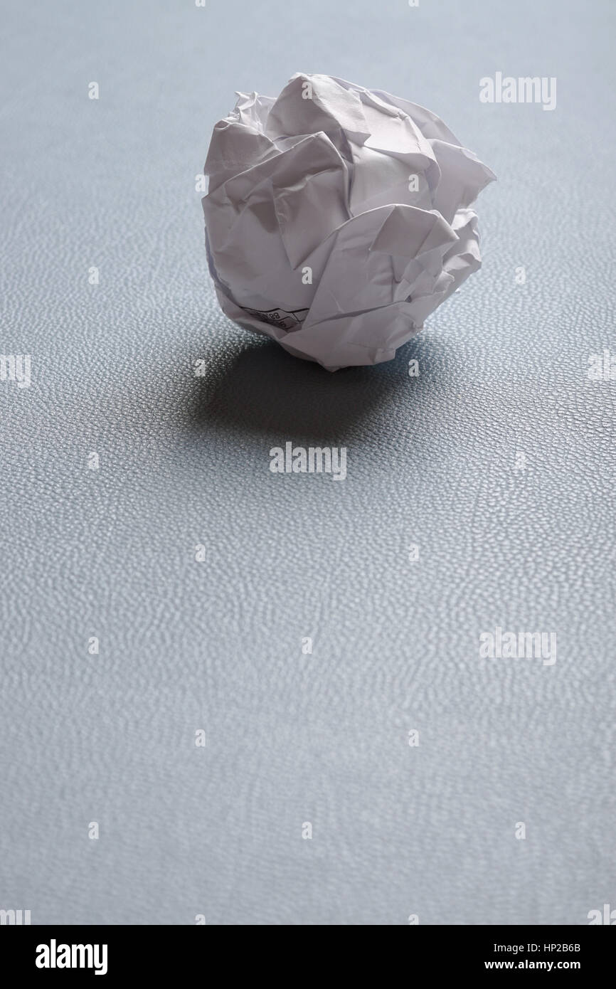 crumpled-up ball of paper - Stock Image