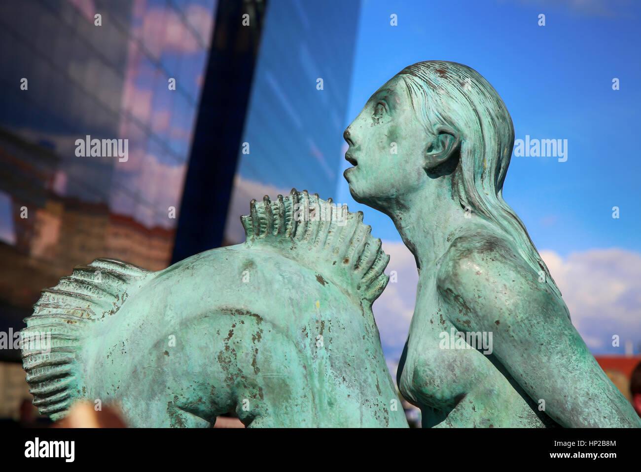 Mermaid statue in front of the main harbour The Black Diamond, The Copenhagen Royal Library (Det Kongelige Bibliotek) Stock Photo