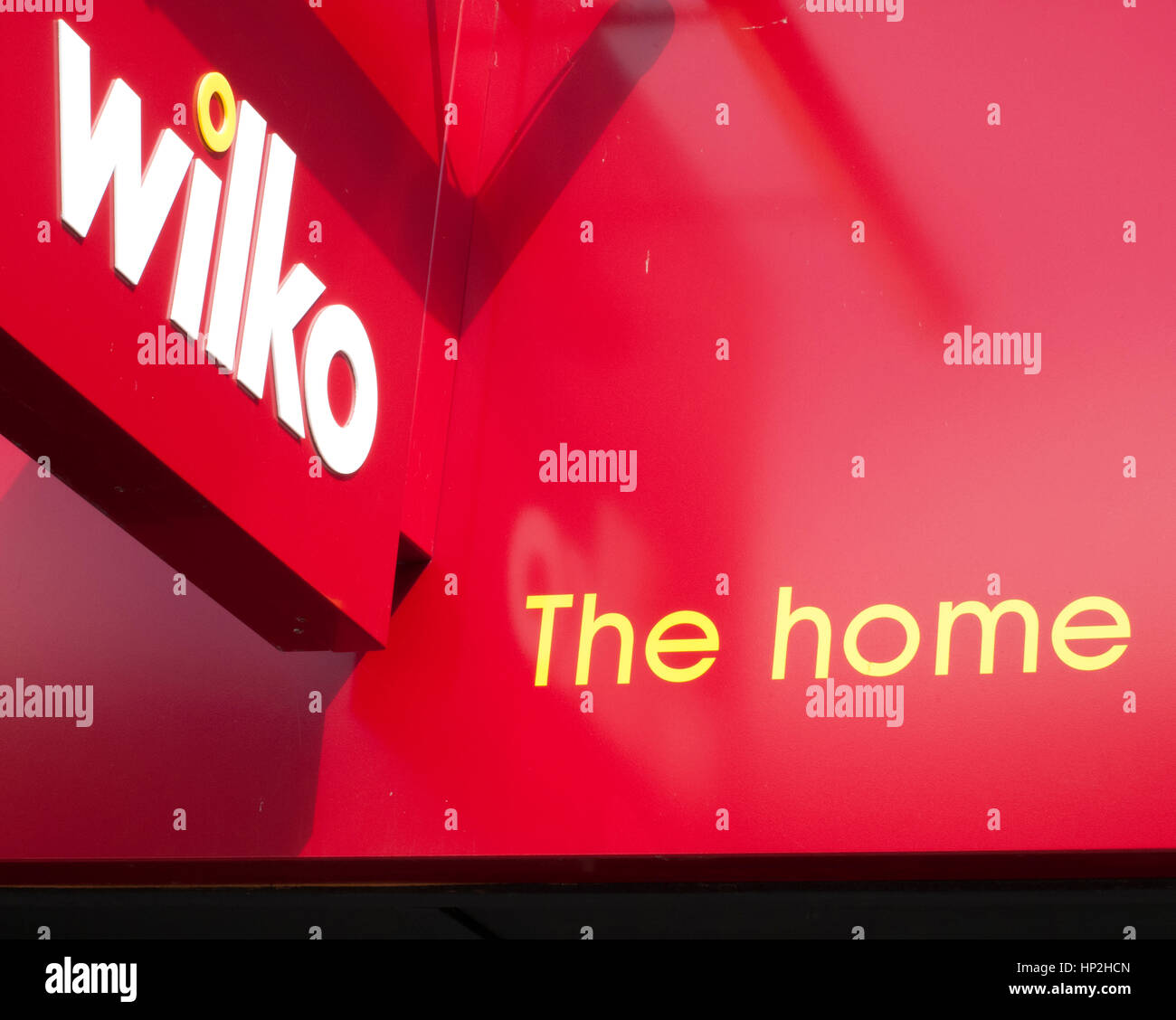 Wilko shop sign over store entrance retails homeware and household goods - Stock Image