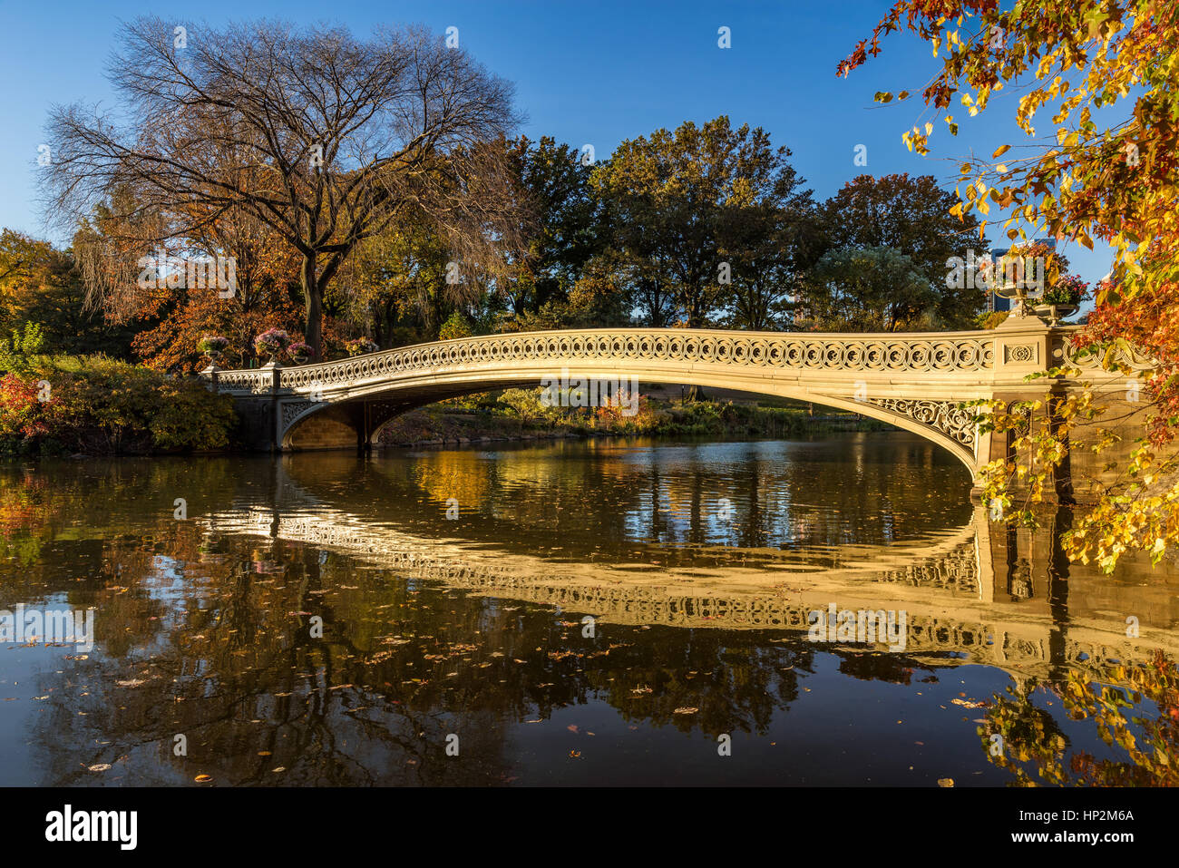 Fall in Central Park at The Lake with the Bow Bridge. Manhattan, New York City - Stock Image