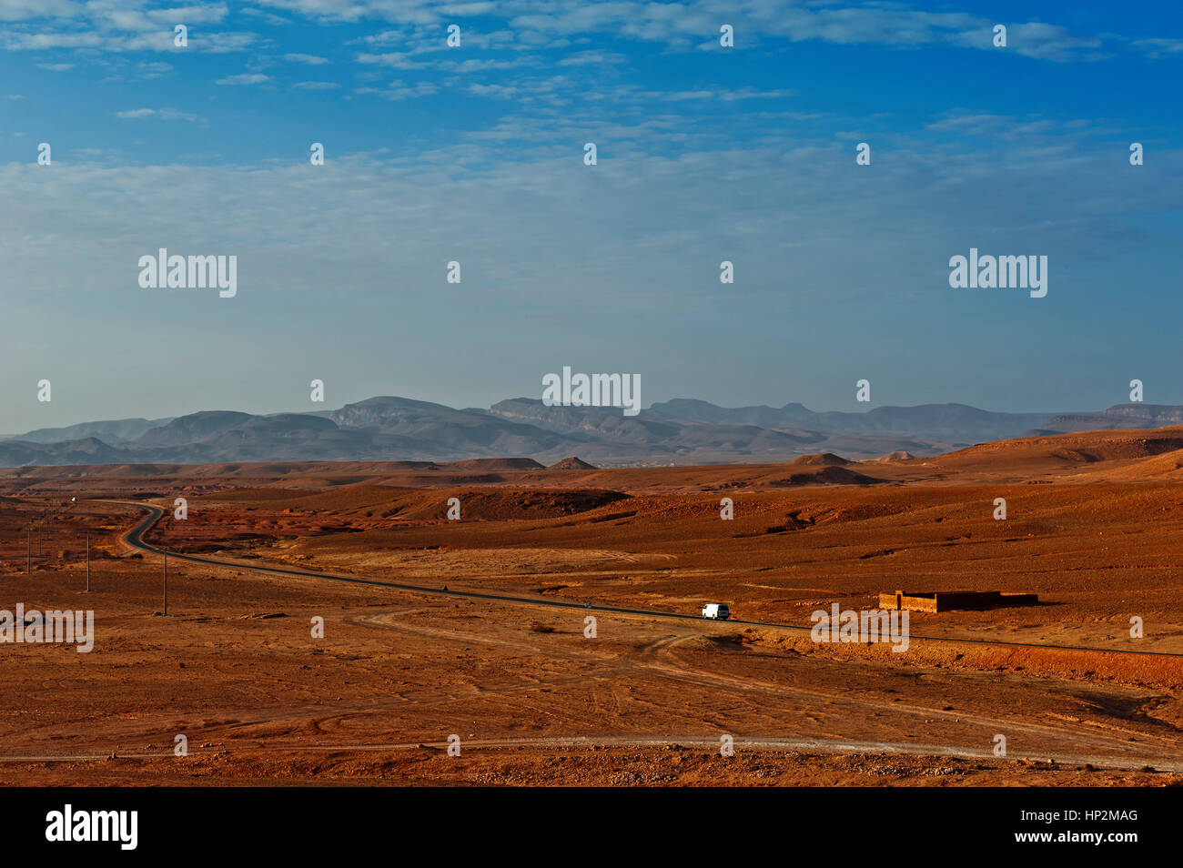 The road through the Moroccan desert in the province of Ouarzazate. Lonely road in Morocco. - Stock Image