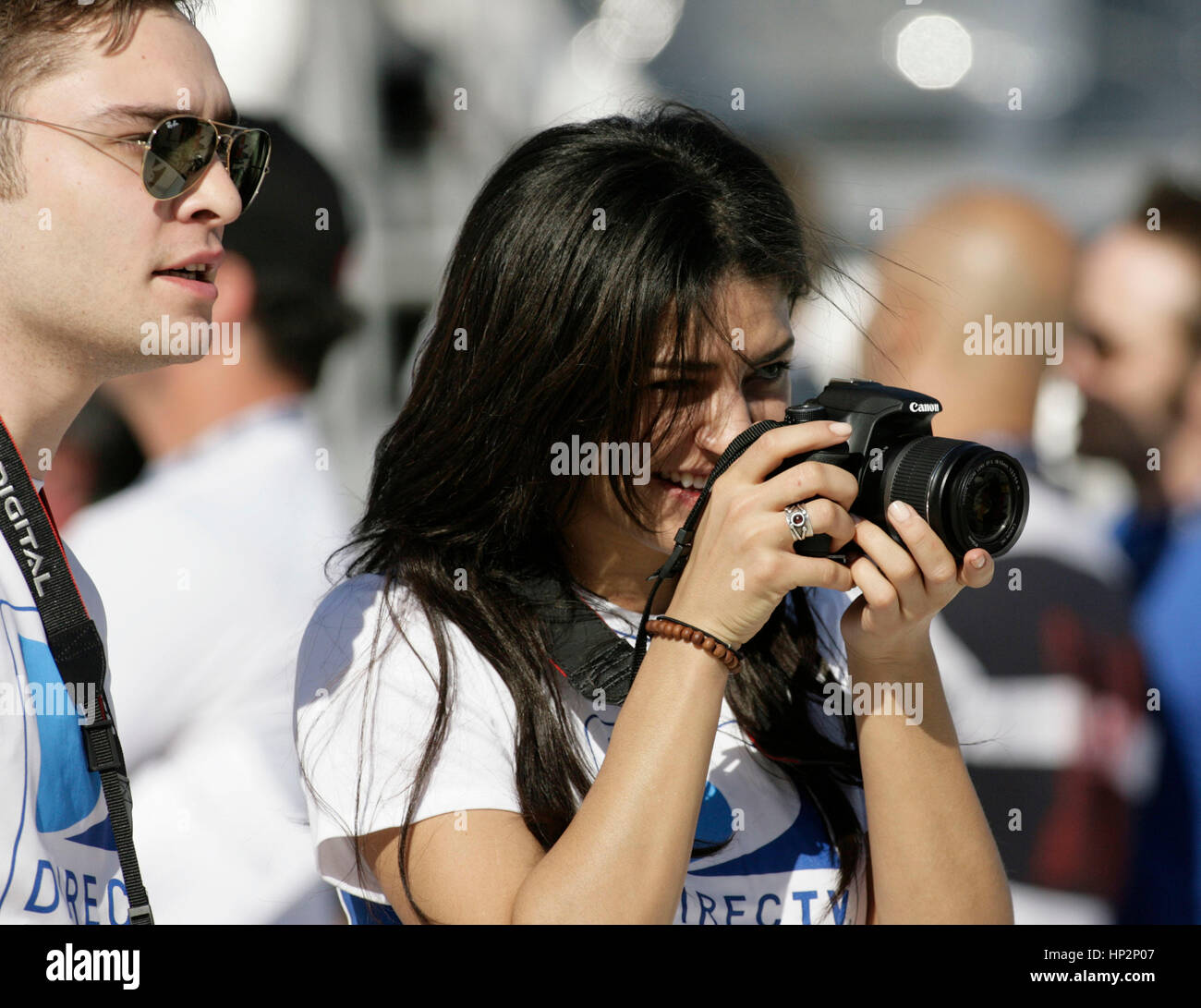 Ed Westwick and Jessica Szohr at the Directv Celebrity Beach Bowl in Miami Beach, Florida on February 6, 2010. Francis - Stock Image