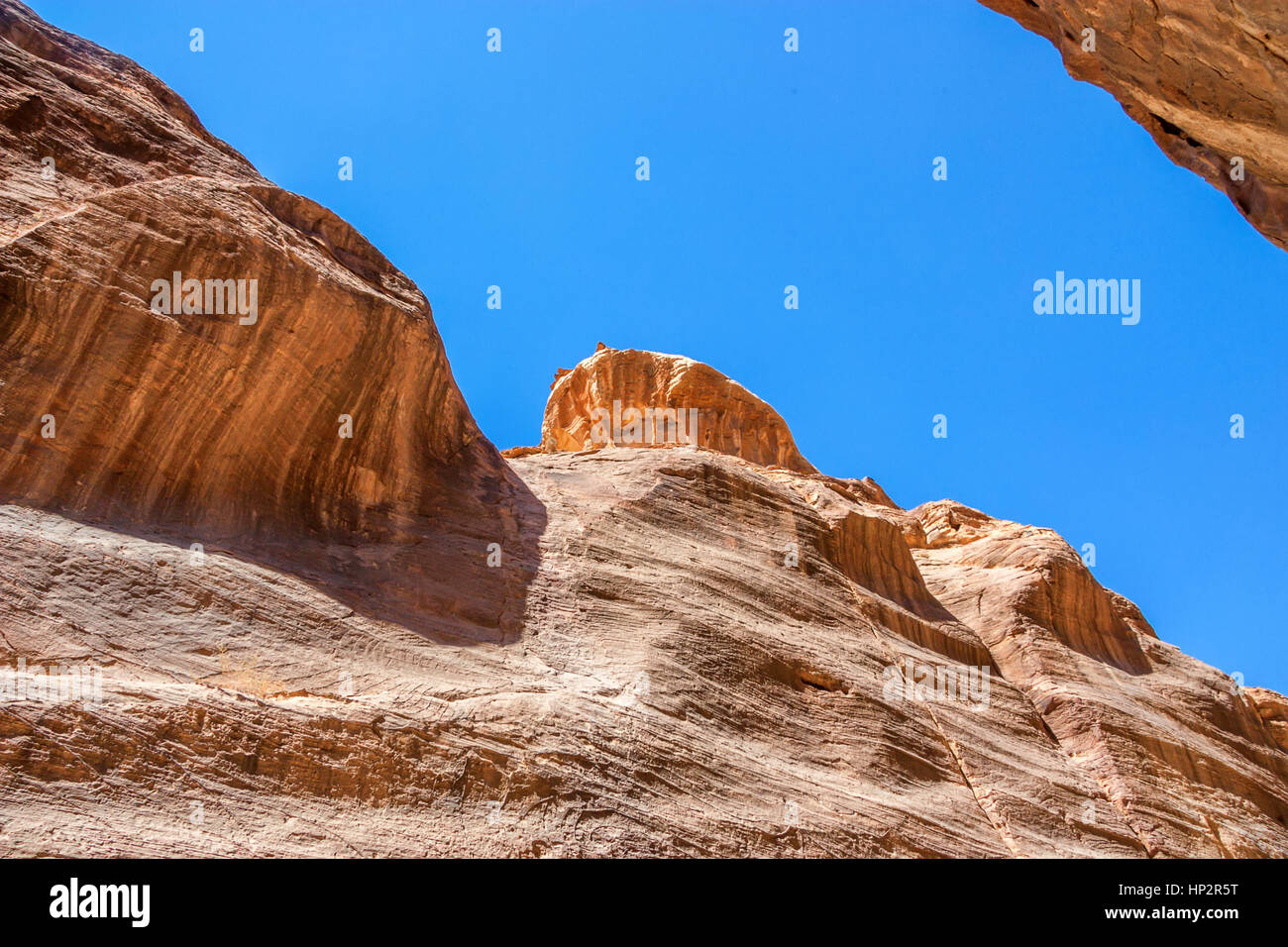 Rocks of pink sandstone in Siq canyon in Petra, Jordan - Stock Image