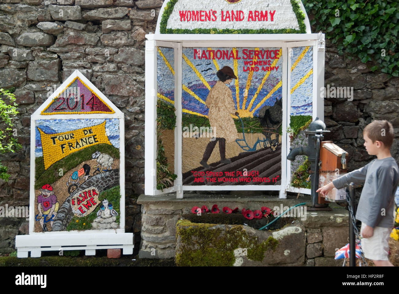 Derbyshire, UK - July 20 2014 - Well dressings commemorate war & celebrate Le Tour on 20 July at Little Longstone, - Stock Image