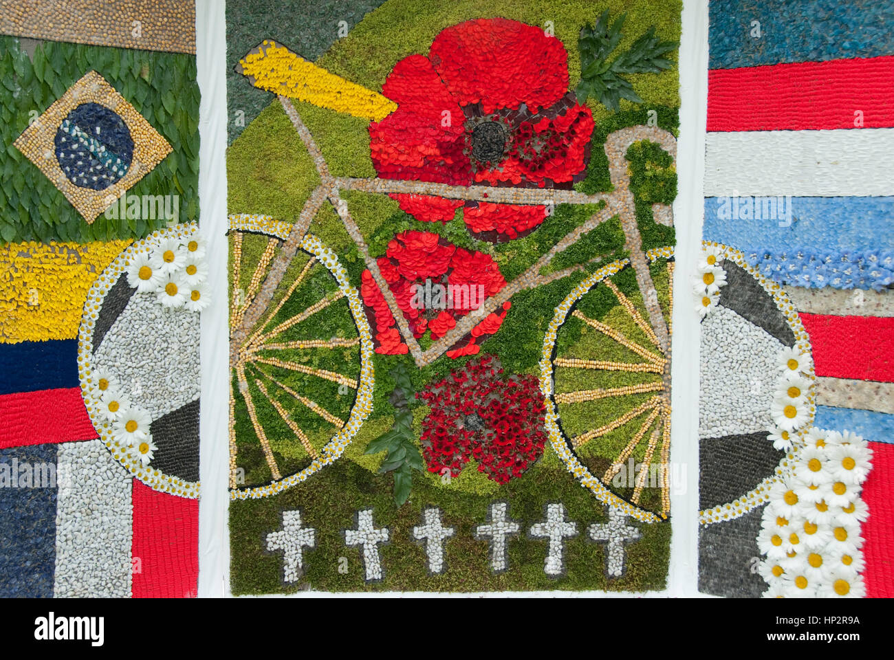 Derbyshire, UK - July 20 2014 - Well dressings commemorate war & celebrate Le Tour on 20 July at Great Longstone, - Stock Image