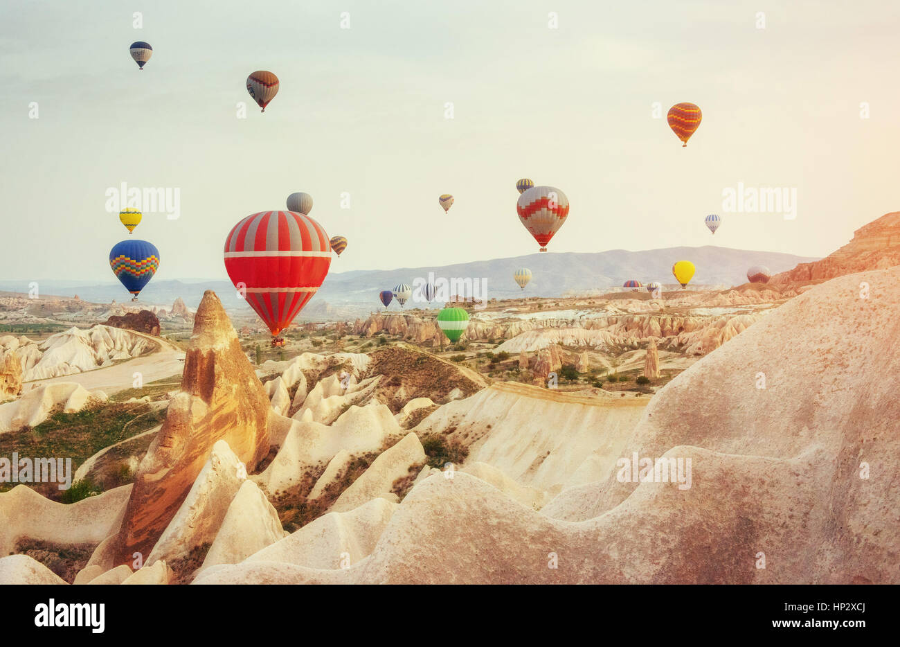 Colorful hot air balloons flying over Red valley at Cappadocia,  - Stock Image