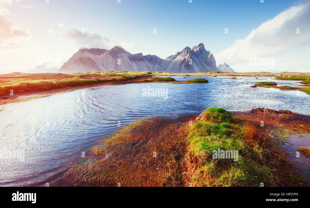 Gentle slopes snowy mountains and glaciers. Gorgeous autumn Icel - Stock Image