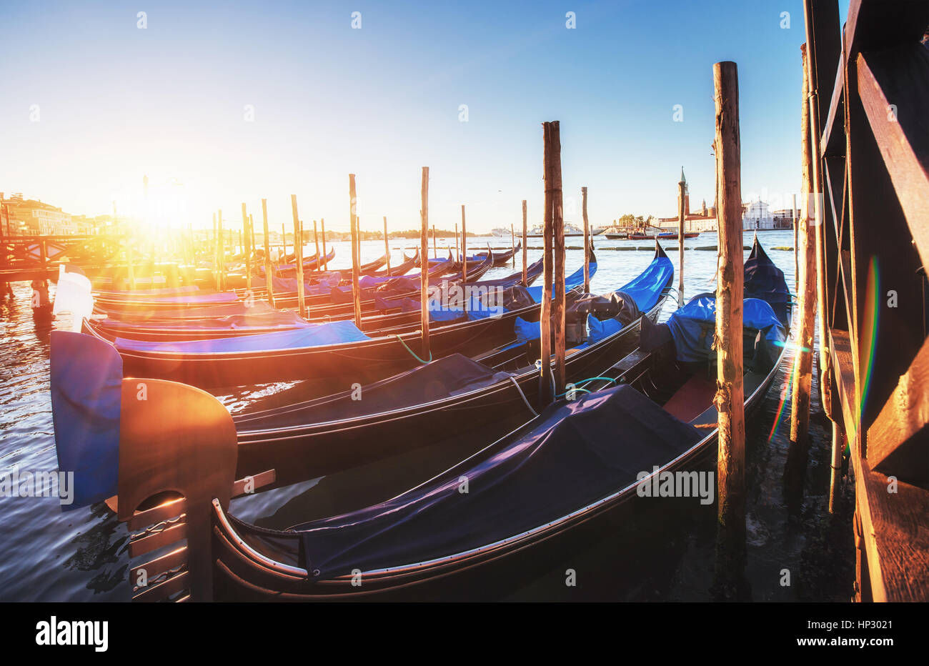 City landscape. Fantastic views of the gondola at sunset, moored - Stock Image