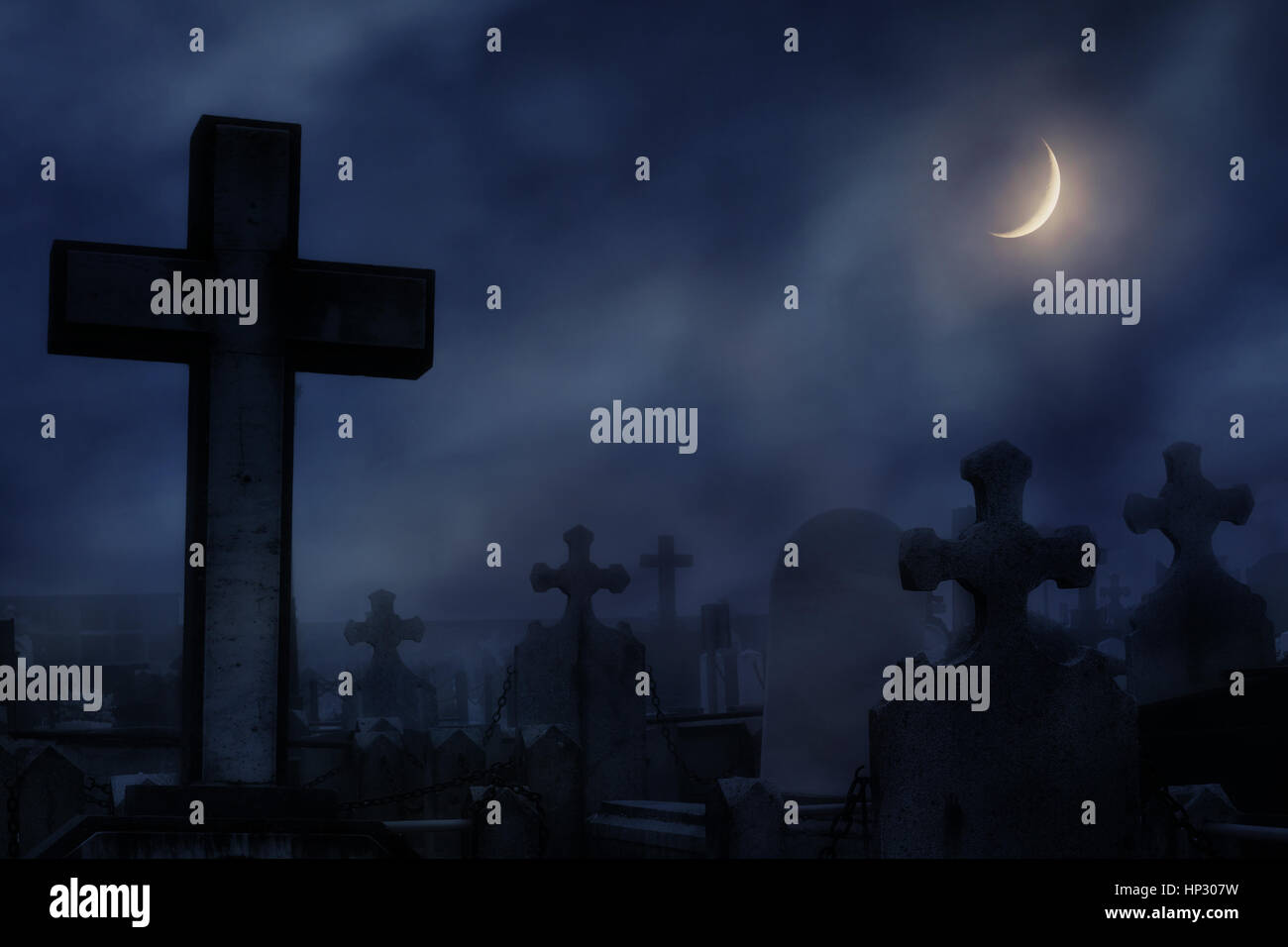 cemetery at night with moonlight - Stock Image