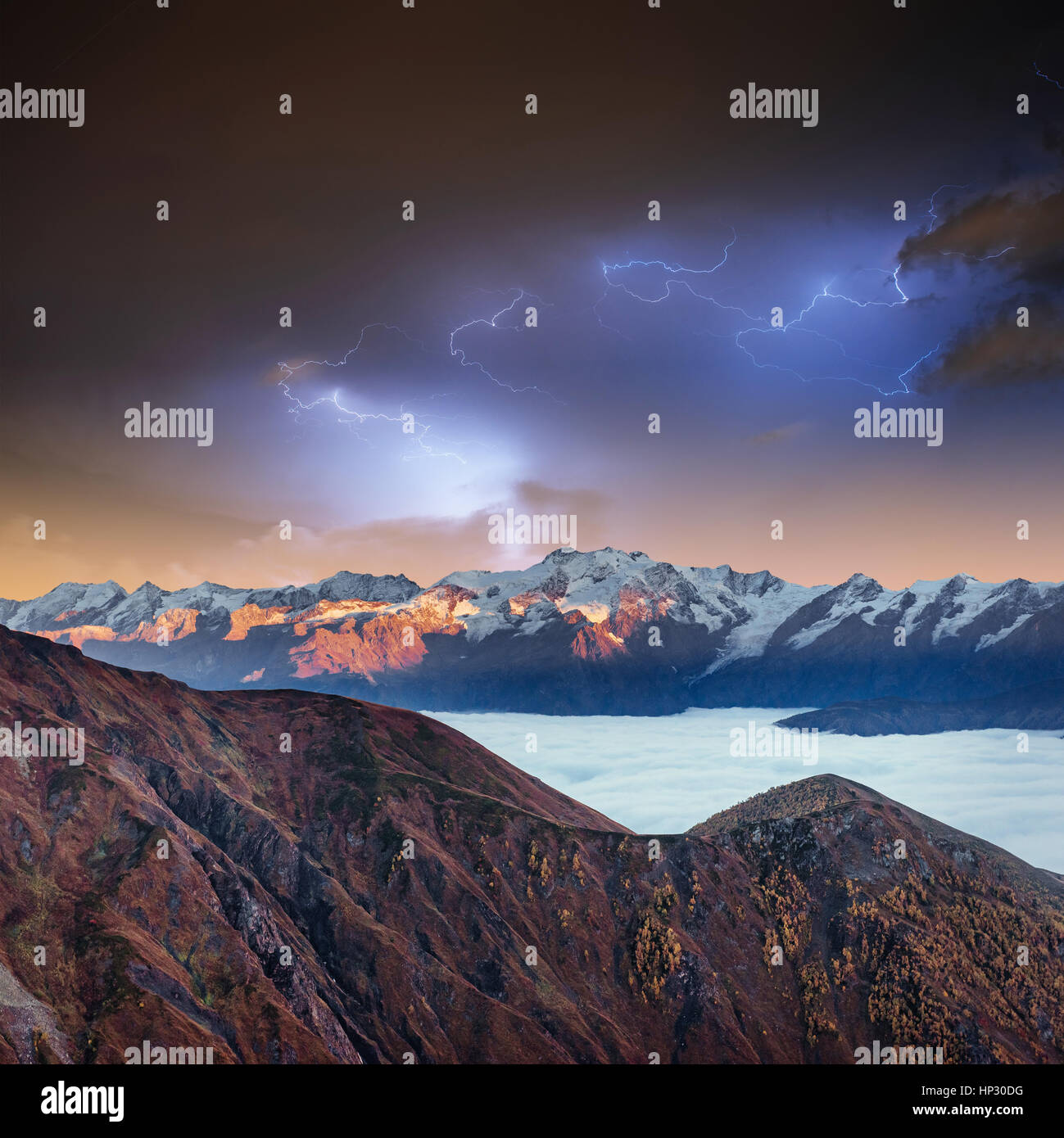 Fantastic collage. Beautiful lightning over the snow-capped - Stock Image