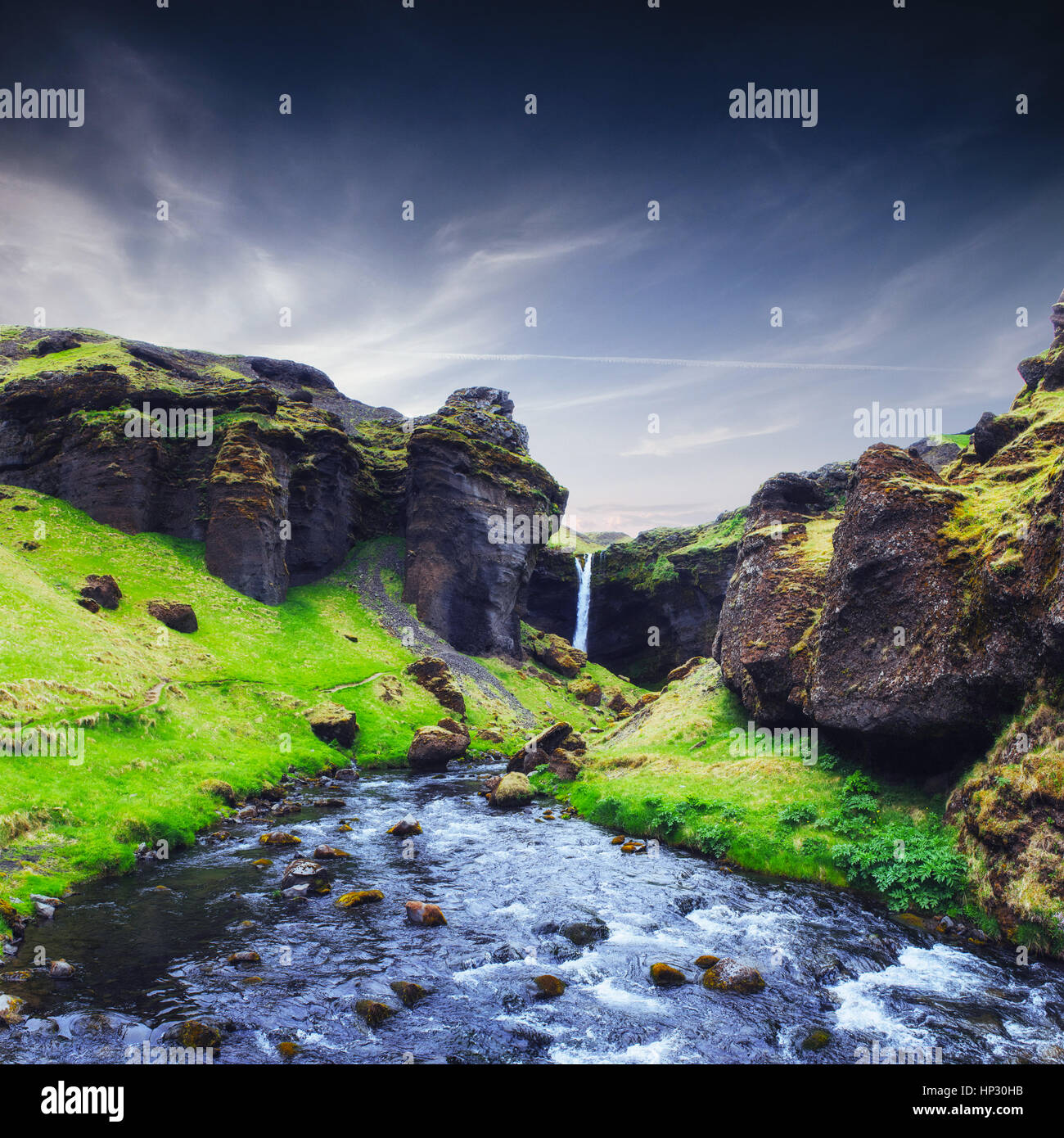 Fantastic landscape of mountains and waterfalls in Iceland - Stock Image