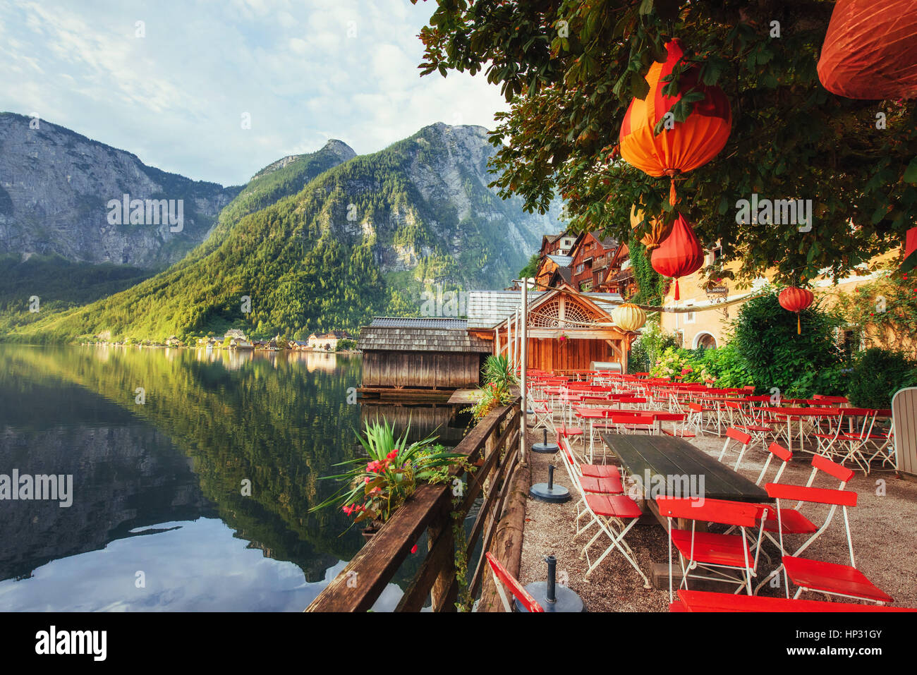 Summer cafe on the beautiful lake between mountains. Alps. Halls - Stock Image