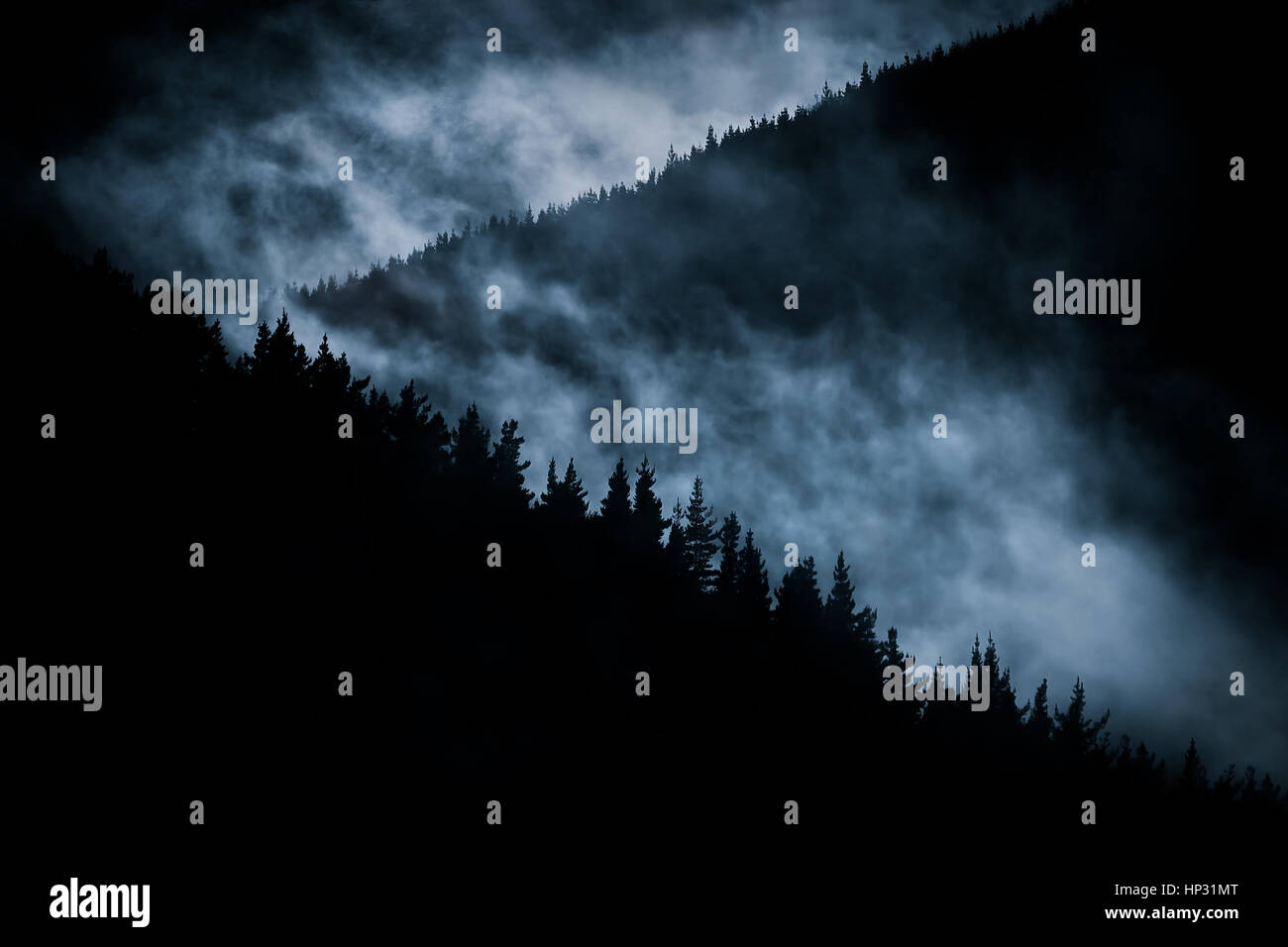 scary foggy mountain at nigh - Stock Image