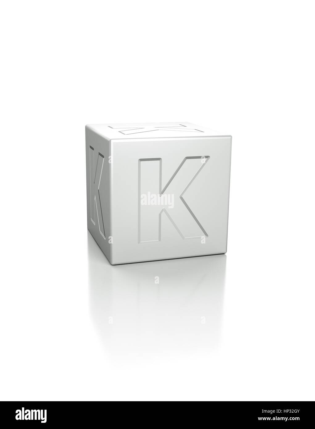 Cube with the letter K embossed. - Stock Image