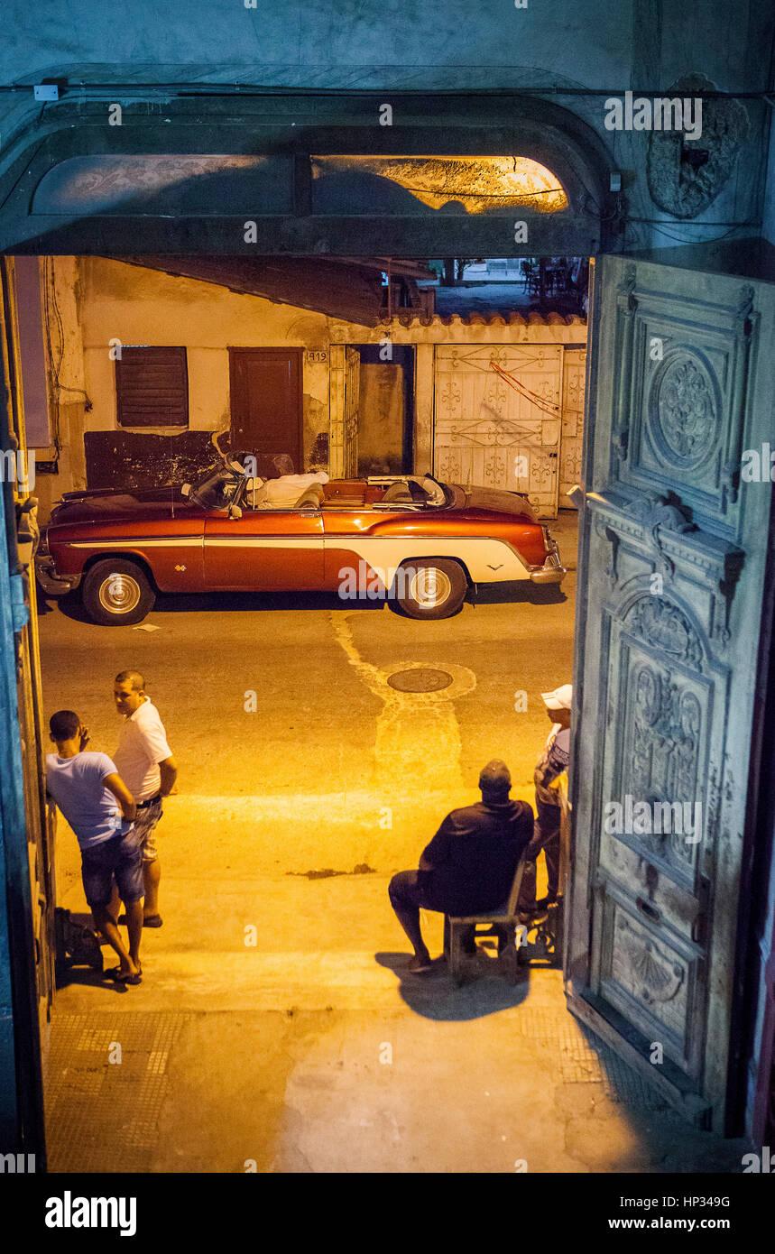 Taxi, cab, taxicab, Street scene in Concordia street, entry to La Guarida restaurant,Centro Habana District, La - Stock Image