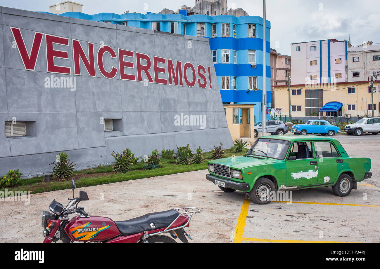 Political message, Catchword in Anti-imperialist Tribune Jose Marti and vintage car, Vedado district, La Habana, Stock Photo