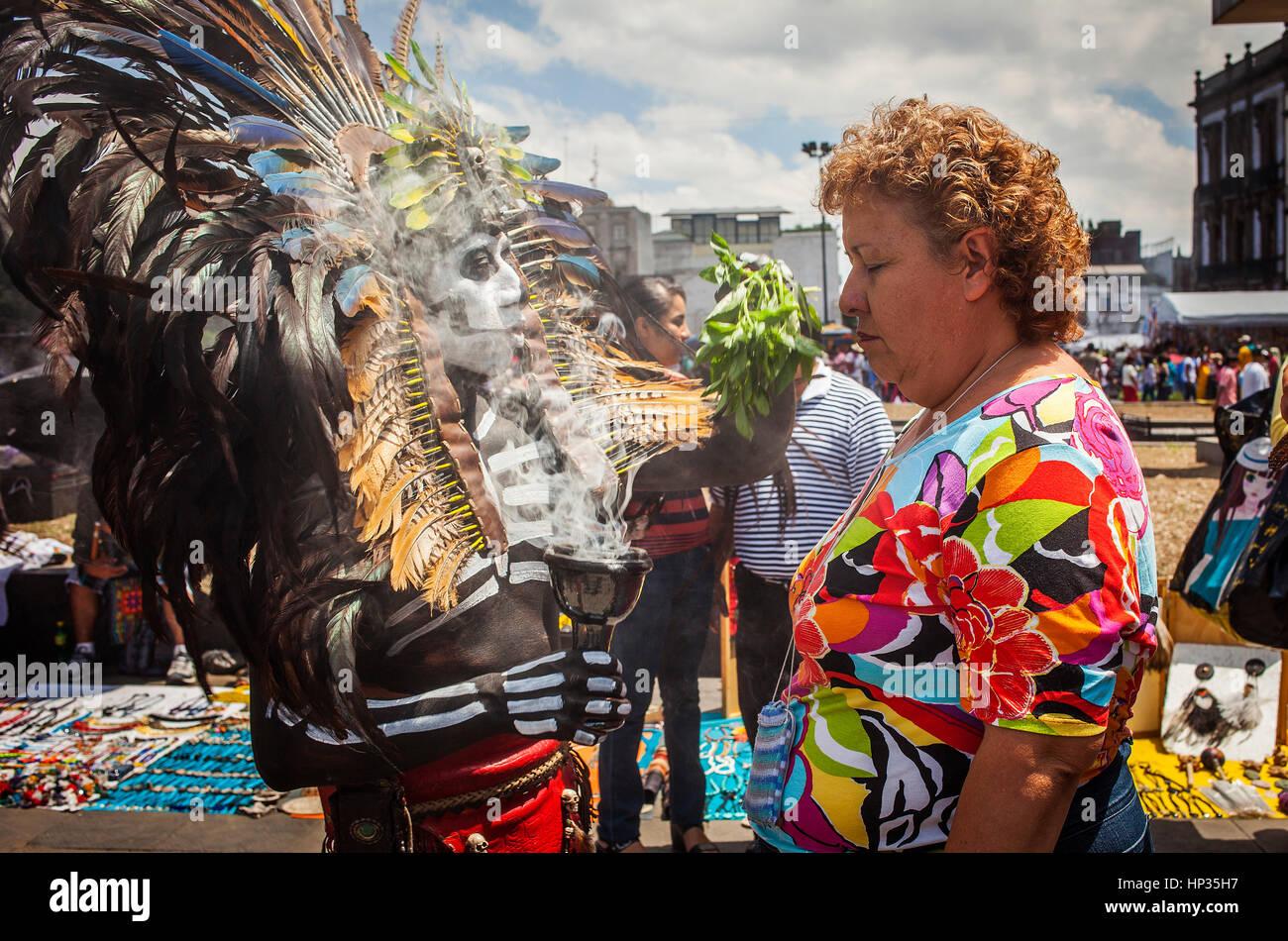 Aztec folk healer, shaman practising spiritual cleansing,Plaza de la Constitución, El Zocalo, Zocalo Square, - Stock Image
