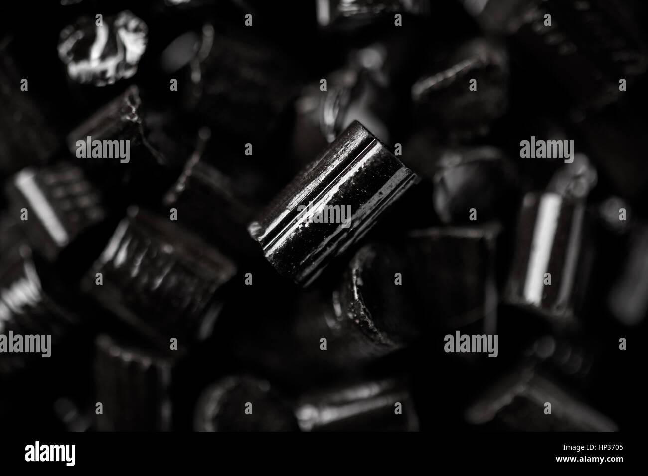 Black Licorice Lozenges Close Up - Stock Image