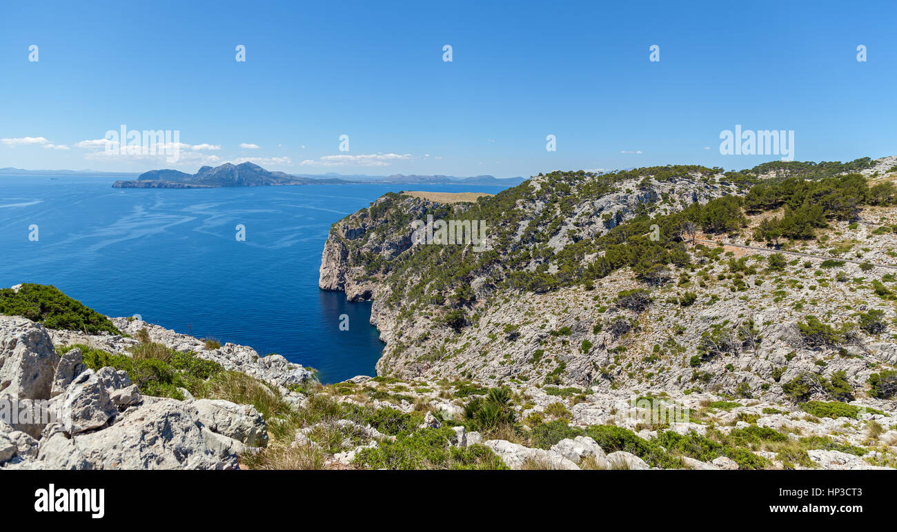 Panorama Mountain cliff. Mountain cliff covered with grass which offers incredible views of the sea and in the distance - Stock Image