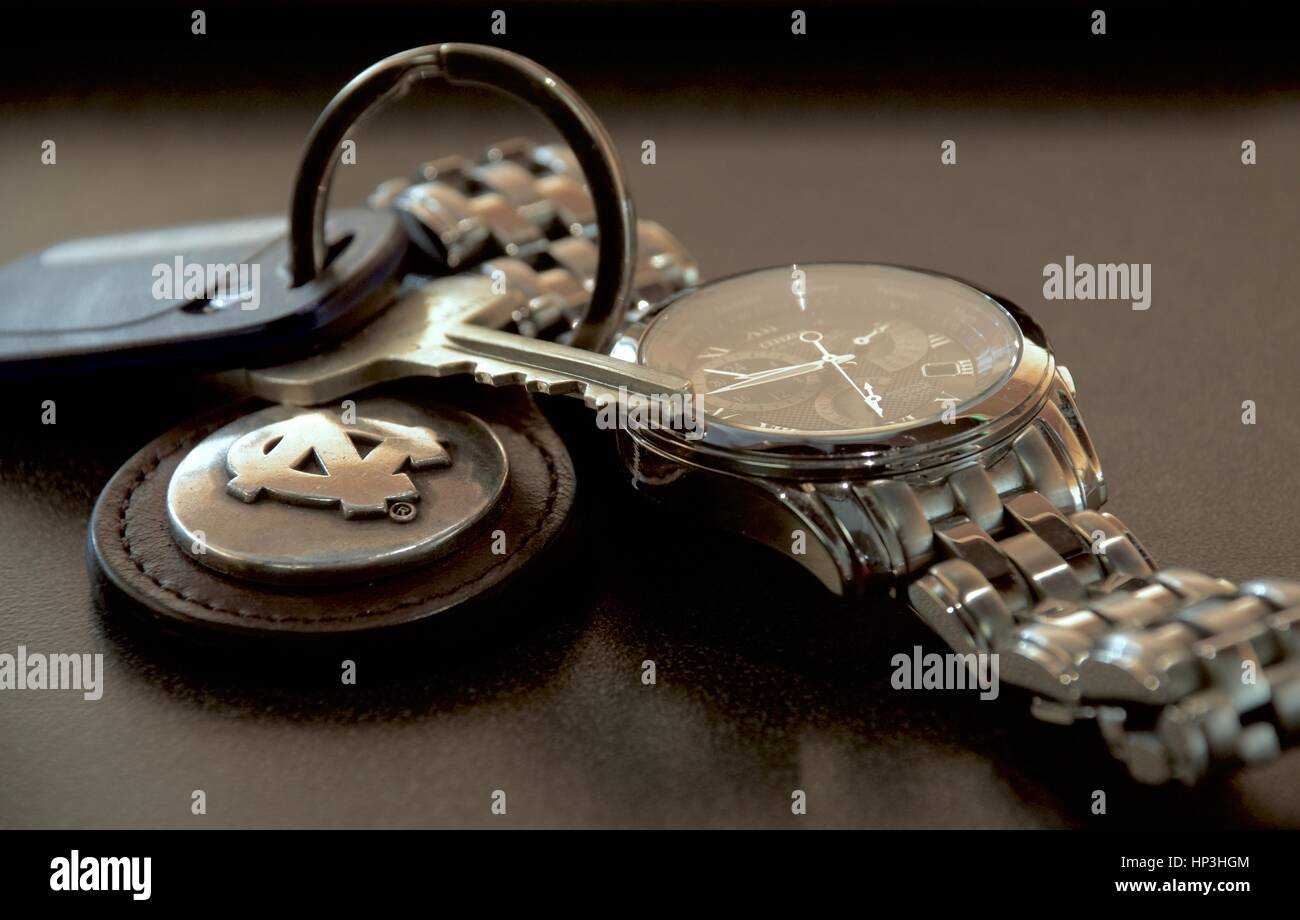 Watch and keychain still life with UNC fob - Stock Image