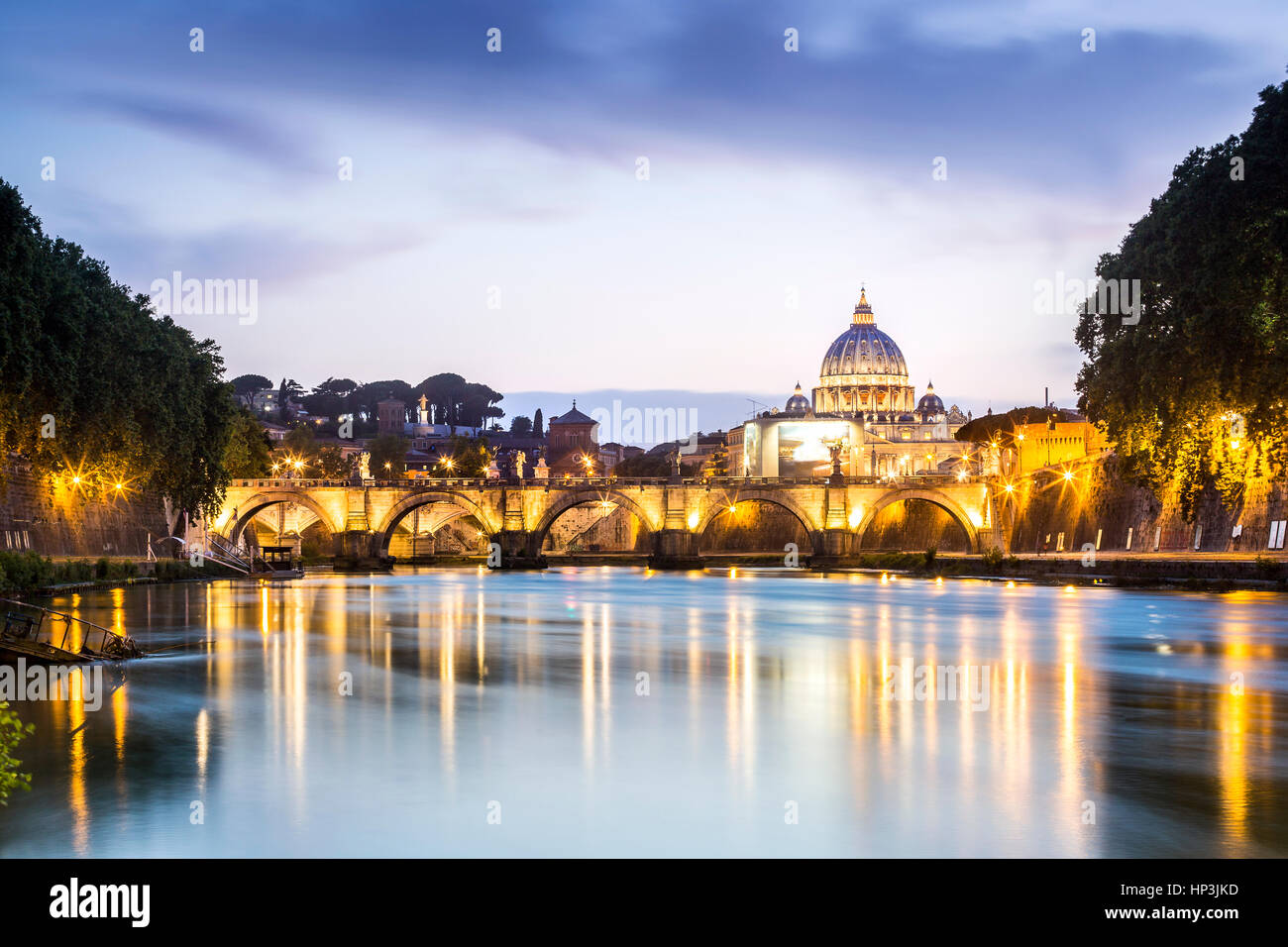 Saint Peter's Basilica with bridge over Tiber, dusk, Rome, Italy - Stock Image