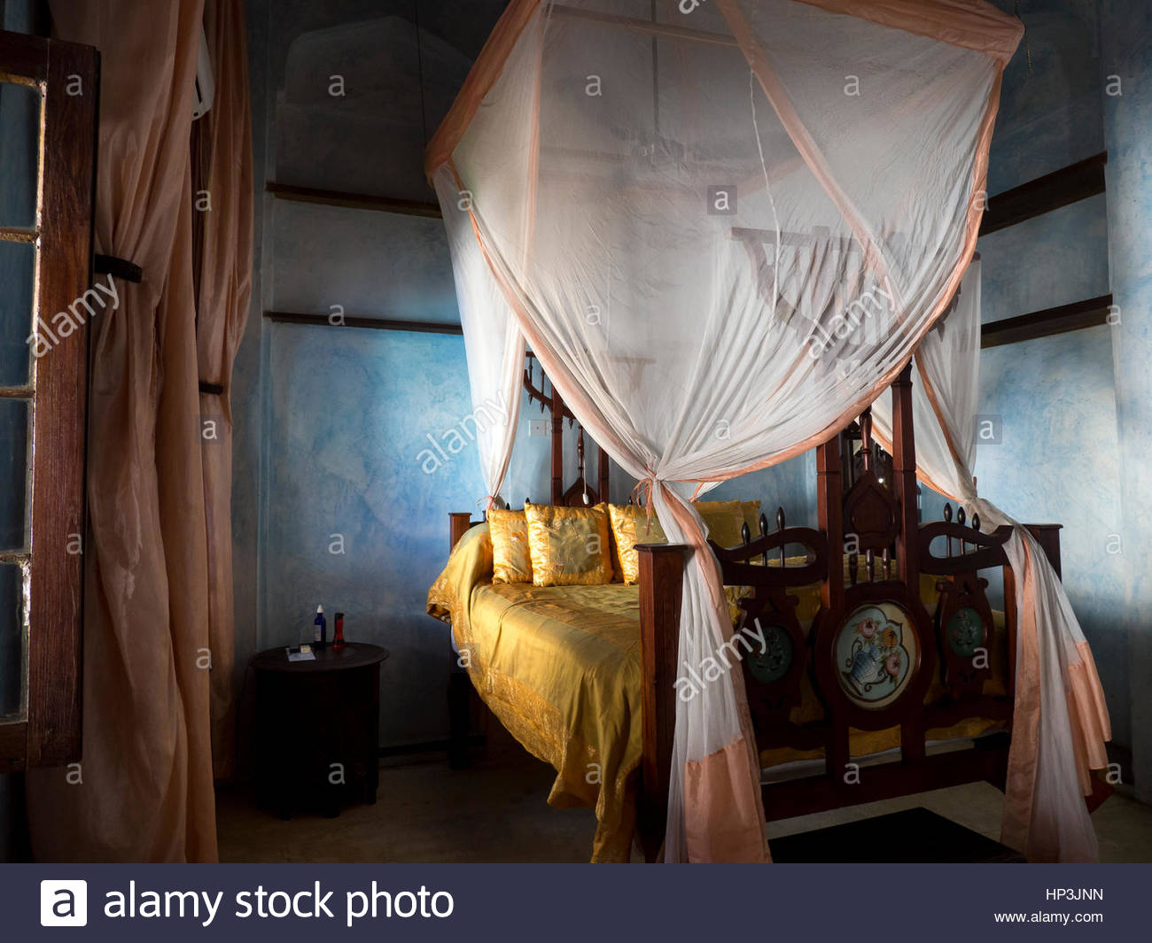 Luxury room with four-poster bed, yellow, Emerson Spice Hotel, Zanzibar Archipelago, Tanzania - Stock Image