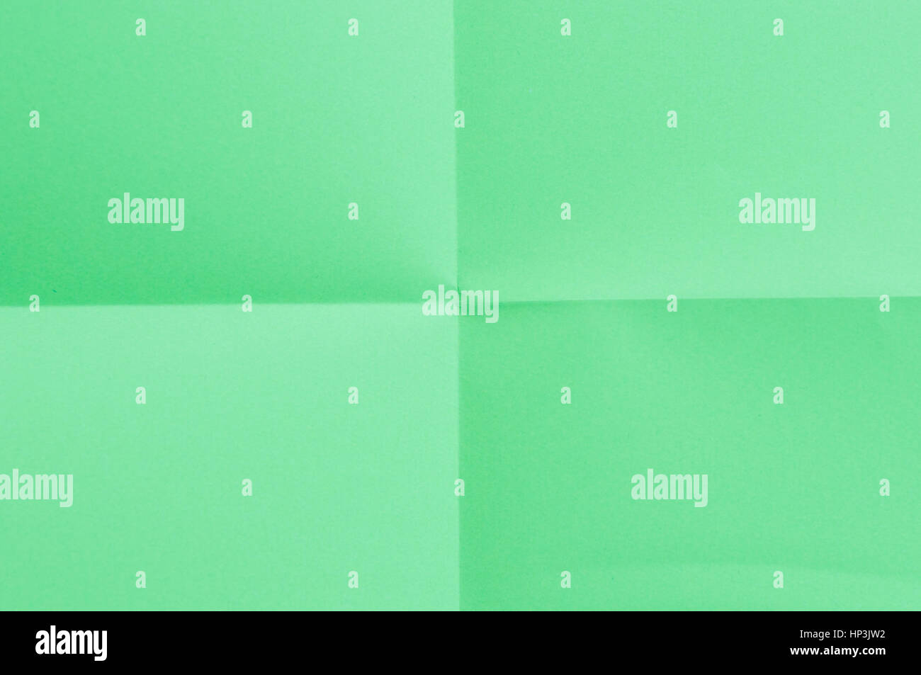 Folded green sheet of paper - close up - Stock Image