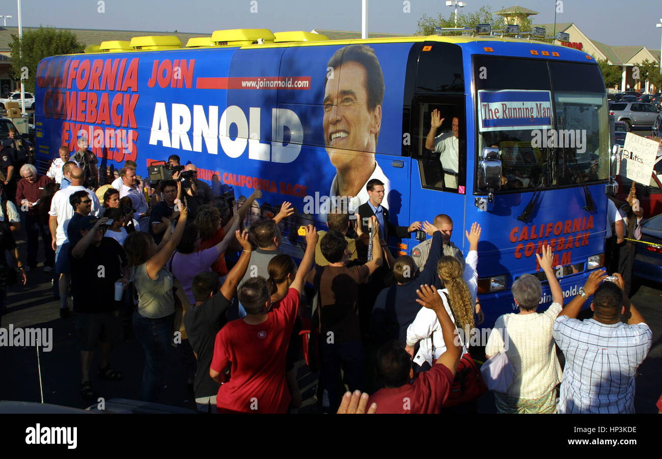 California gubernatorial candidate Arnold Schwarzenegger  waves from the window of his bus as it leaves Bakersfield,Calif. Stock Photo