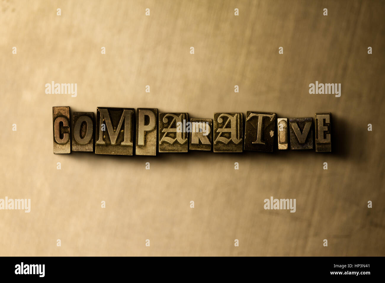 COMPARATIVE - close-up of grungy vintage typeset word on metal backdrop. Royalty free stock illustration.  Can be - Stock Image