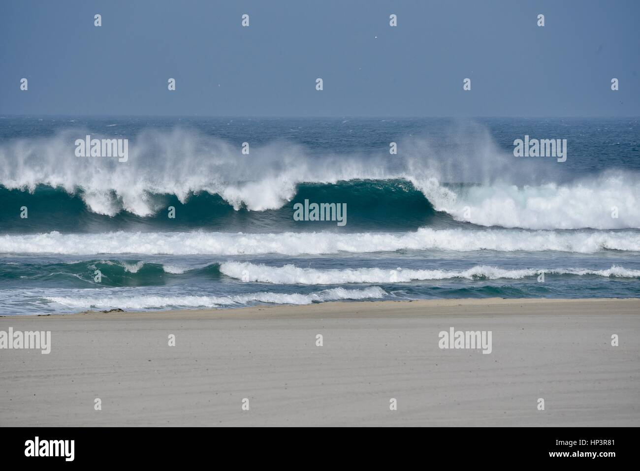 Severe weather, high surf and waves crash upon shore of Mission Beach, San Diego,  California. - Stock Image