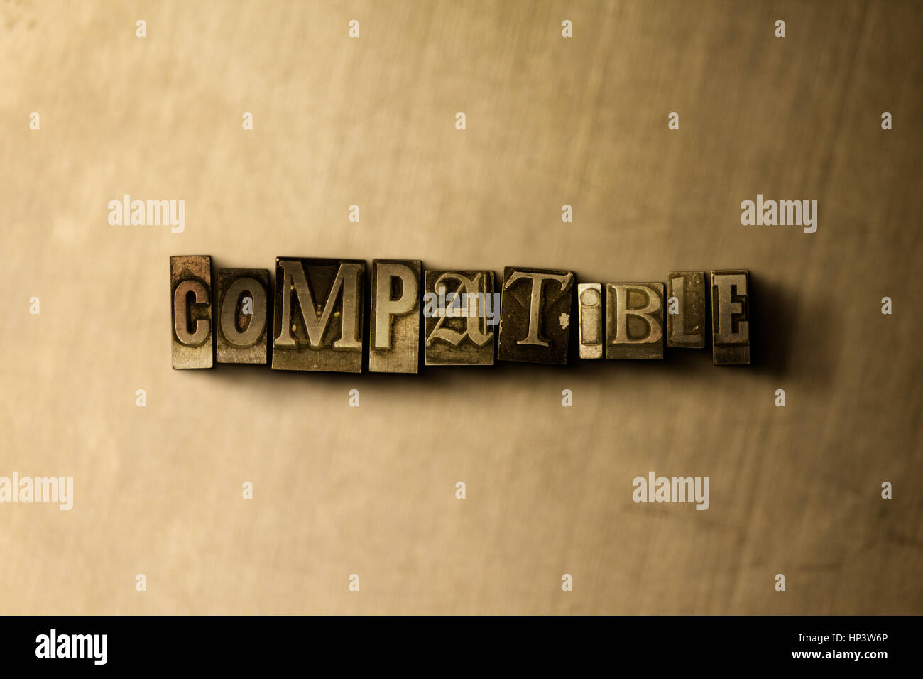 COMPATIBLE - close-up of grungy vintage typeset word on metal backdrop. Royalty free stock illustration.  Can be - Stock Image
