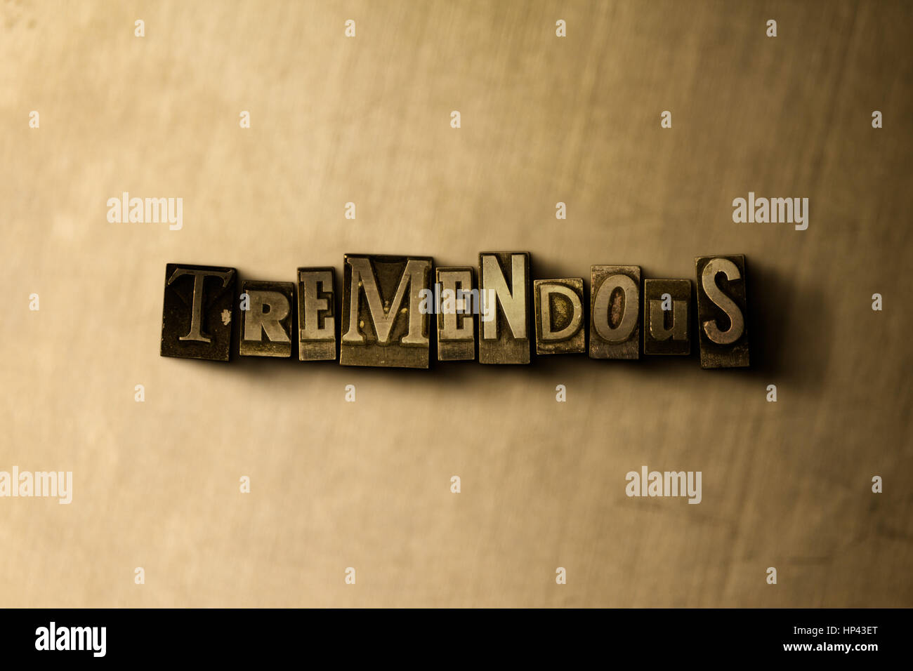TREMENDOUS - close-up of grungy vintage typeset word on metal backdrop. Royalty free stock illustration.  Can be Stock Photo