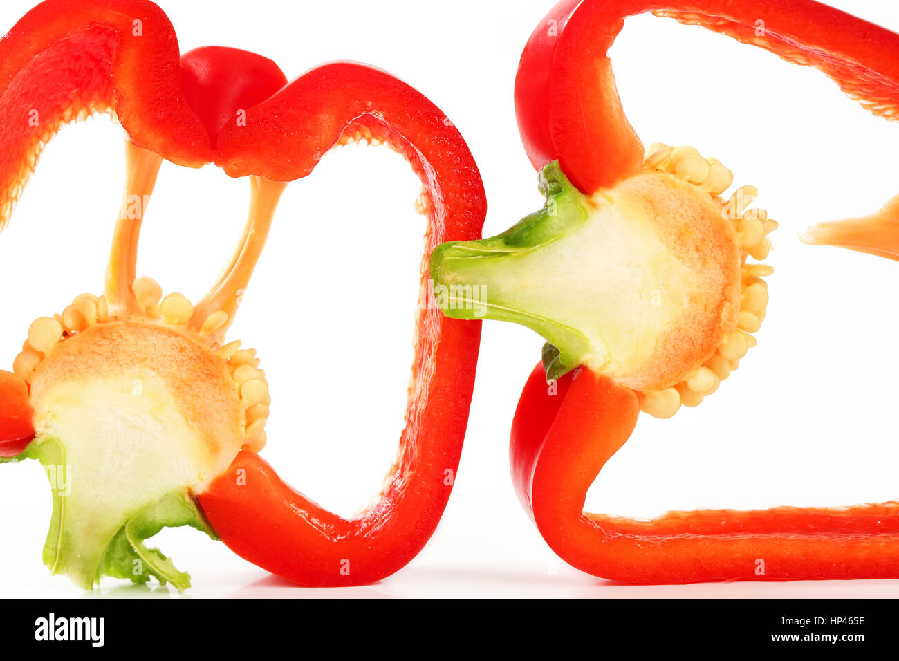 detail of two slices of red pepper on white background - Stock Image