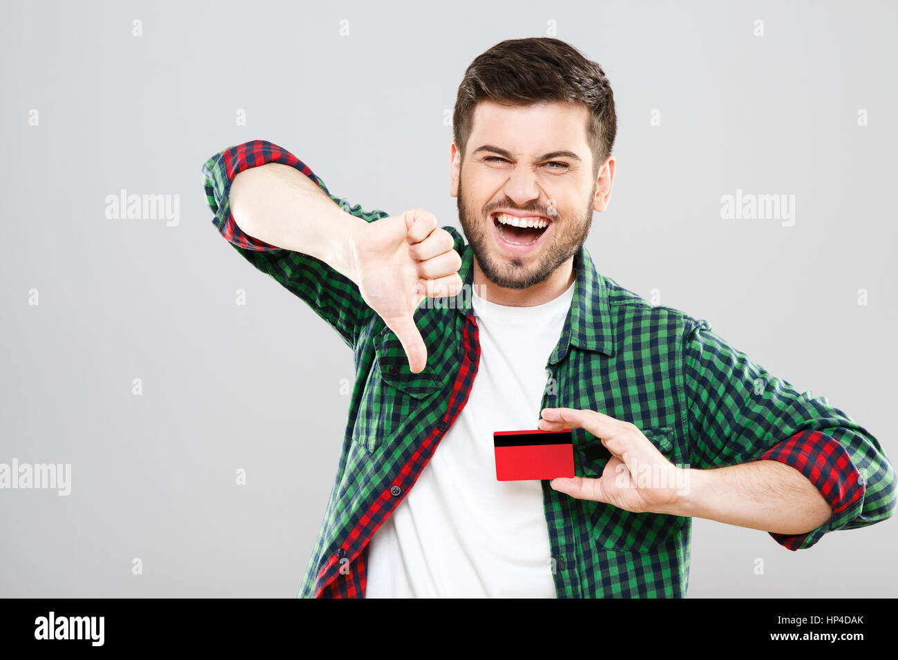 Man showing thumbs down - Stock Image