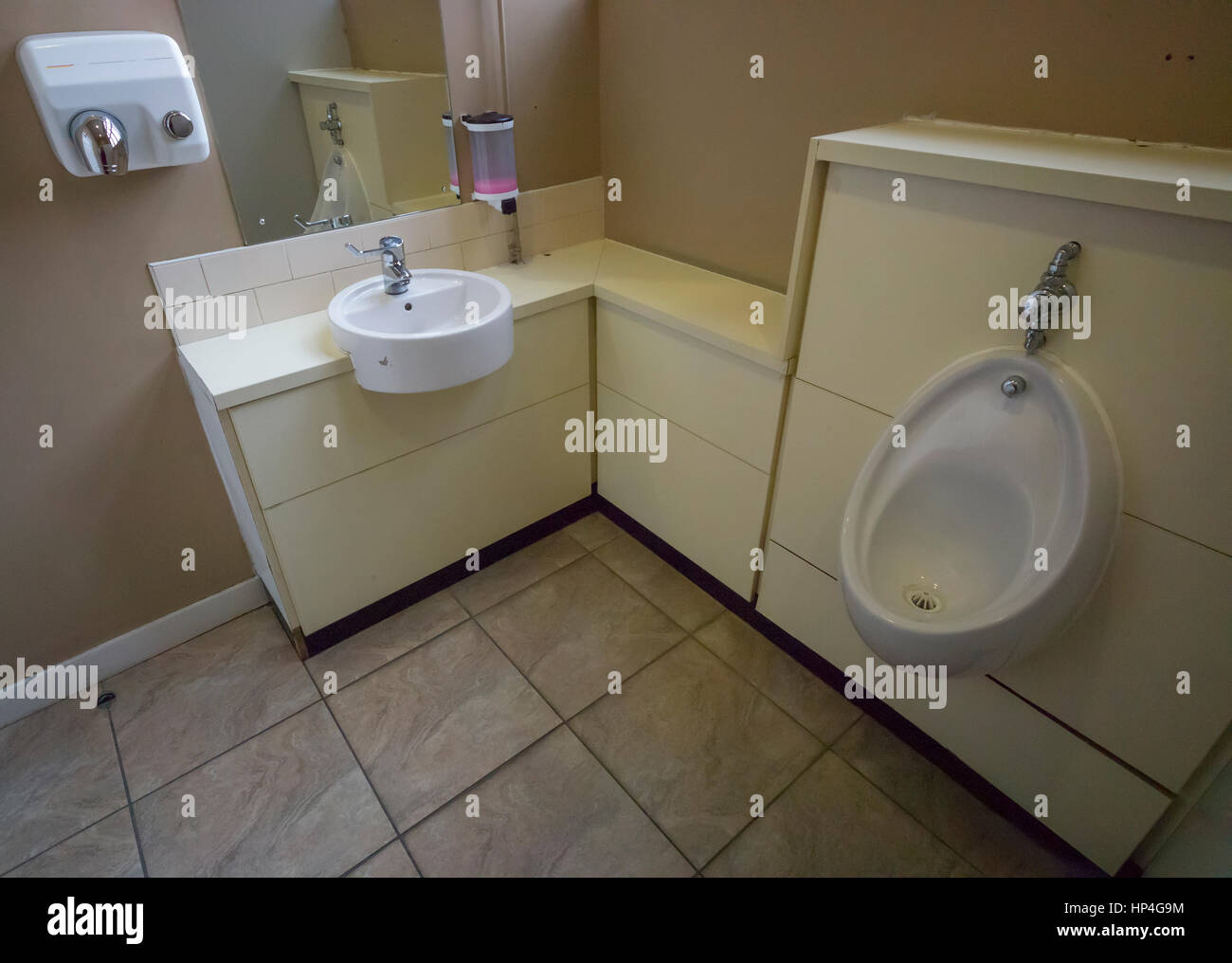 Hot air dryer, washbasin, mirror, soap dispenser, and urinal in toilet,