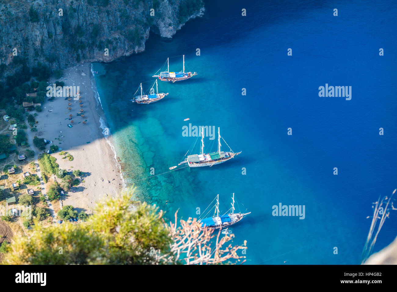 Butterfly Valley sea beach and boats scene - kelebekler vadisi deniz tekne plaj manzara Stock Photo