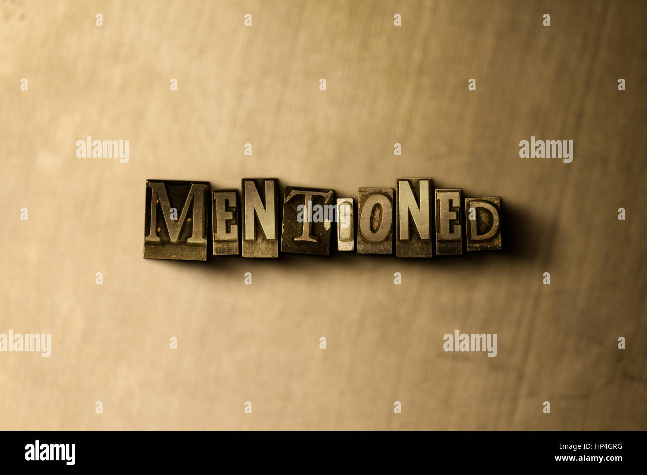 MENTIONED - close-up of grungy vintage typeset word on metal backdrop. Royalty free stock illustration.  Can be - Stock Image