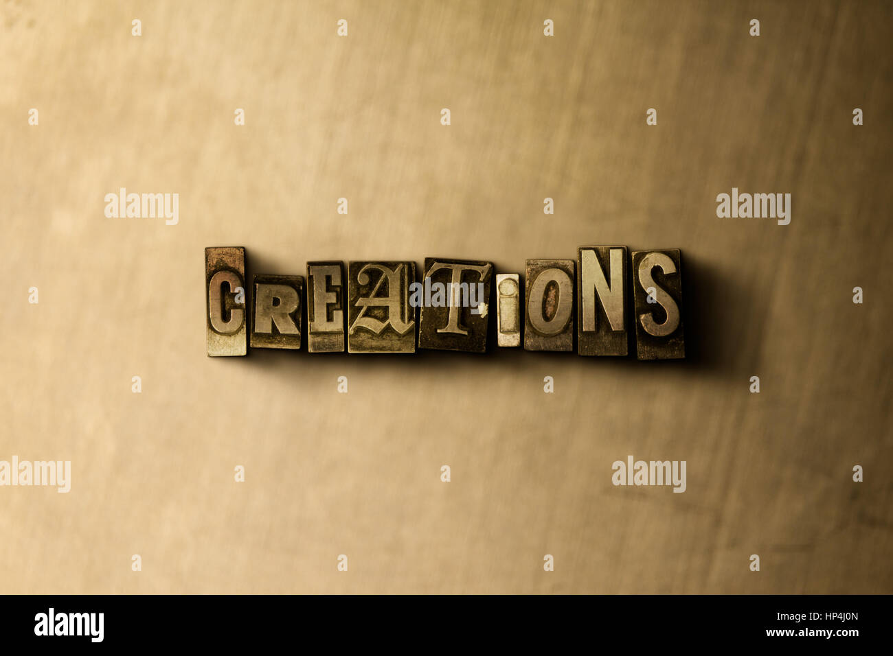 CREATIONS - close-up of grungy vintage typeset word on metal backdrop. Royalty free stock illustration.  Can be - Stock Image