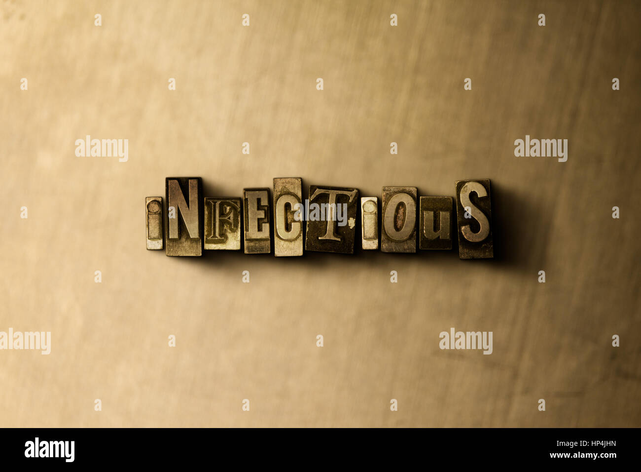 INFECTIOUS - close-up of grungy vintage typeset word on metal backdrop. Royalty free stock illustration.  Can be - Stock Image