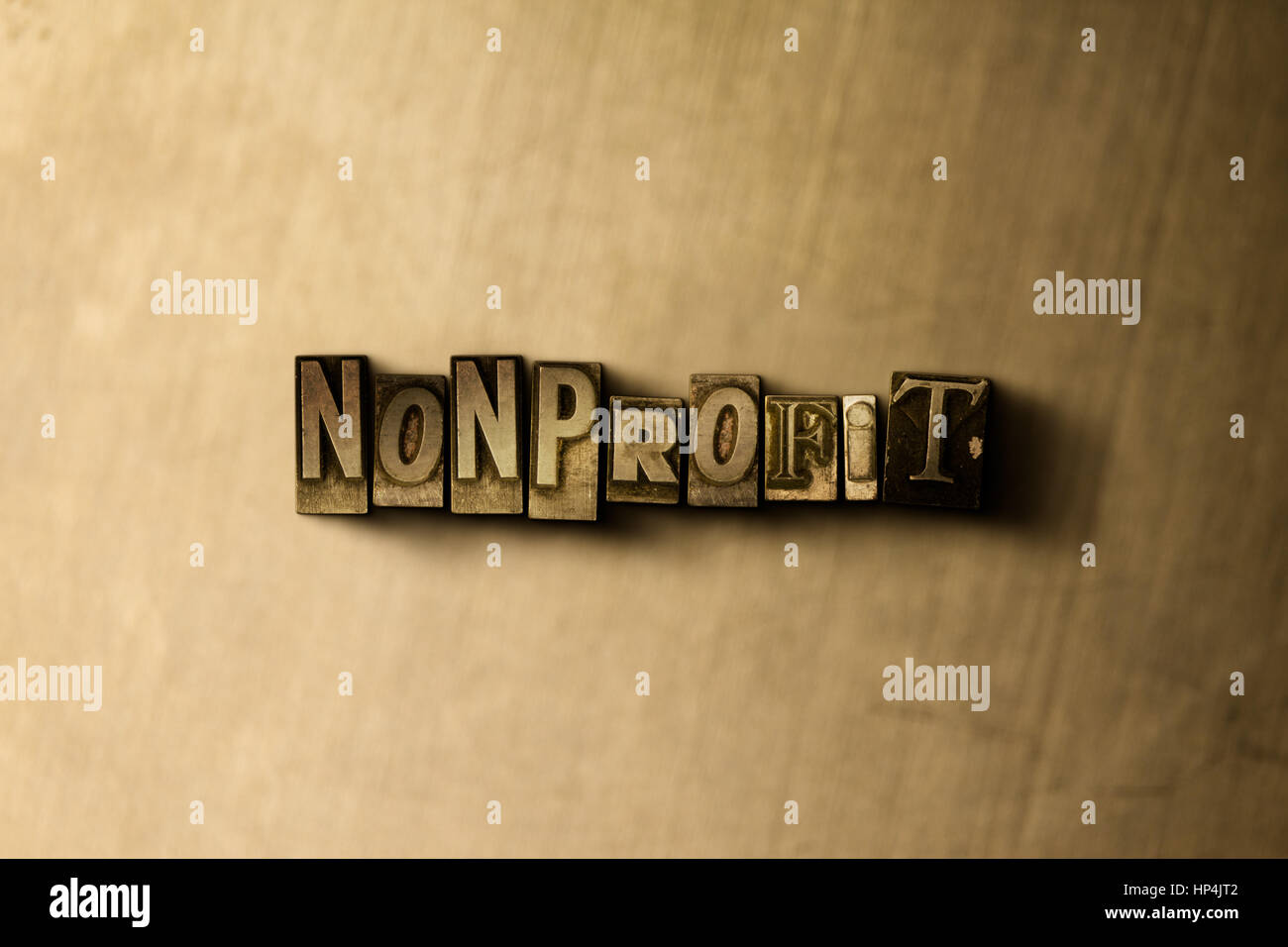 NONPROFIT - close-up of grungy vintage typeset word on metal backdrop. Royalty free stock illustration.  Can be - Stock Image