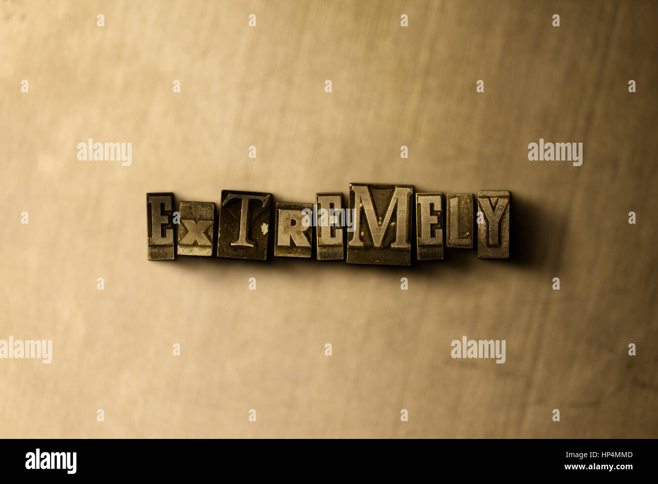 EXTREMELY - close-up of grungy vintage typeset word on metal backdrop. Royalty free stock illustration.  Can be - Stock Image