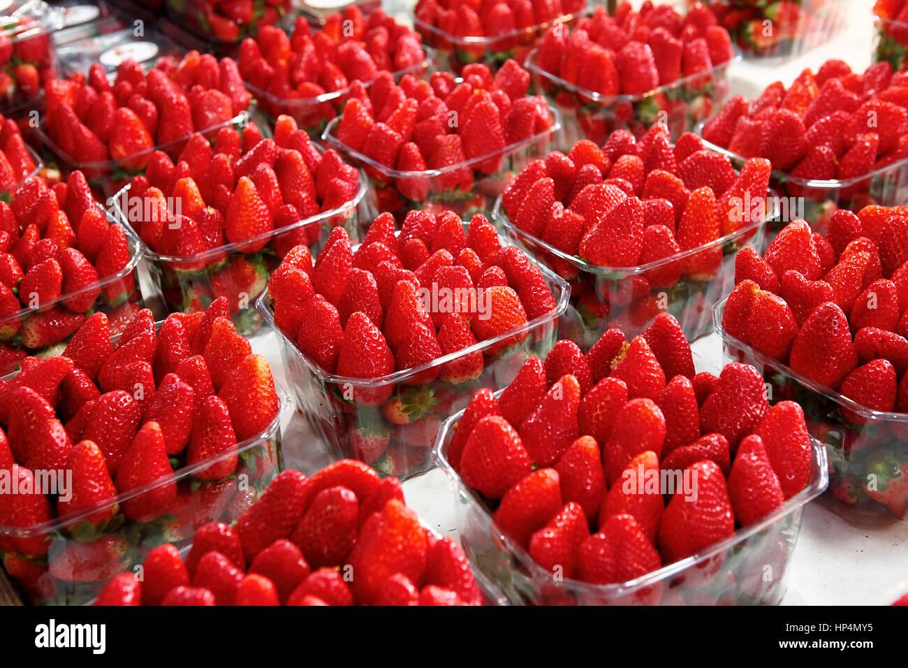 dealer sells fresh israeli strawberries infront of his shop at carmel market, tel aviv, israel Stock Photo