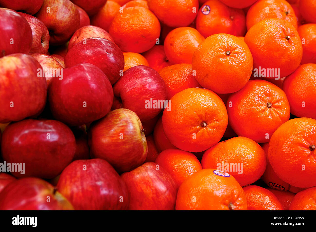 close up apples and oranges at shop in carmel market, tel aviv, israel Stock Photo