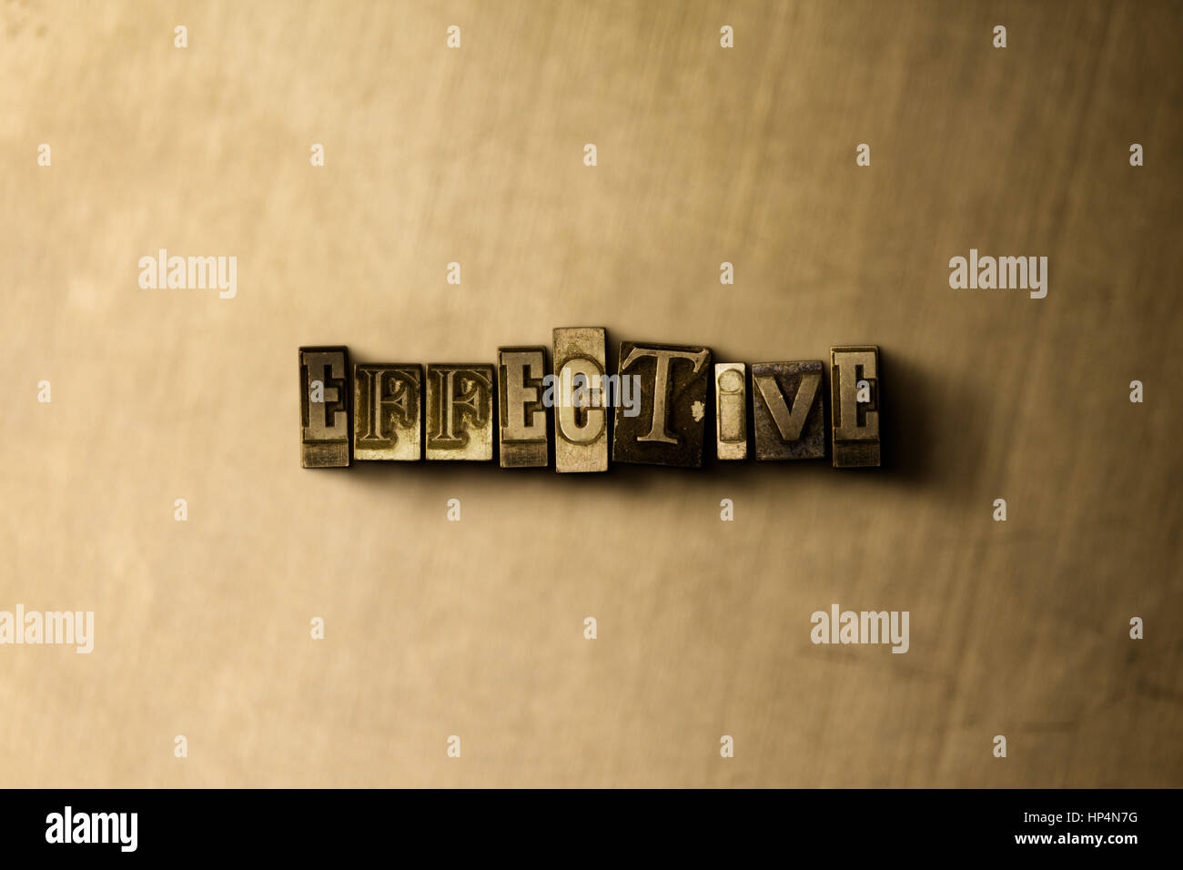 EFFECTIVE - close-up of grungy vintage typeset word on metal backdrop. Royalty free stock illustration.  Can be - Stock Image