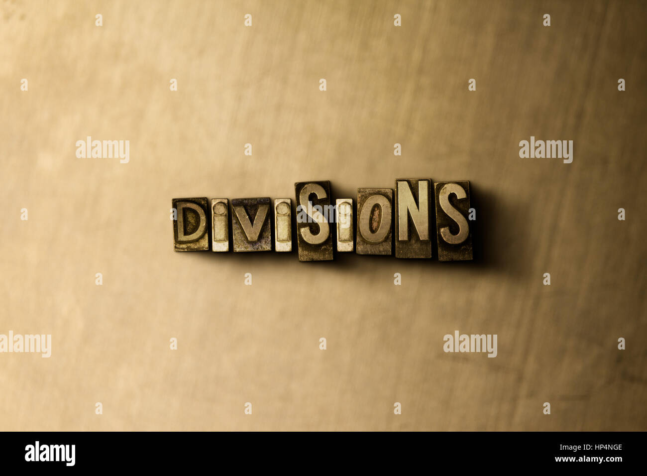 DIVISIONS - close-up of grungy vintage typeset word on metal backdrop. Royalty free stock illustration.  Can be - Stock Image