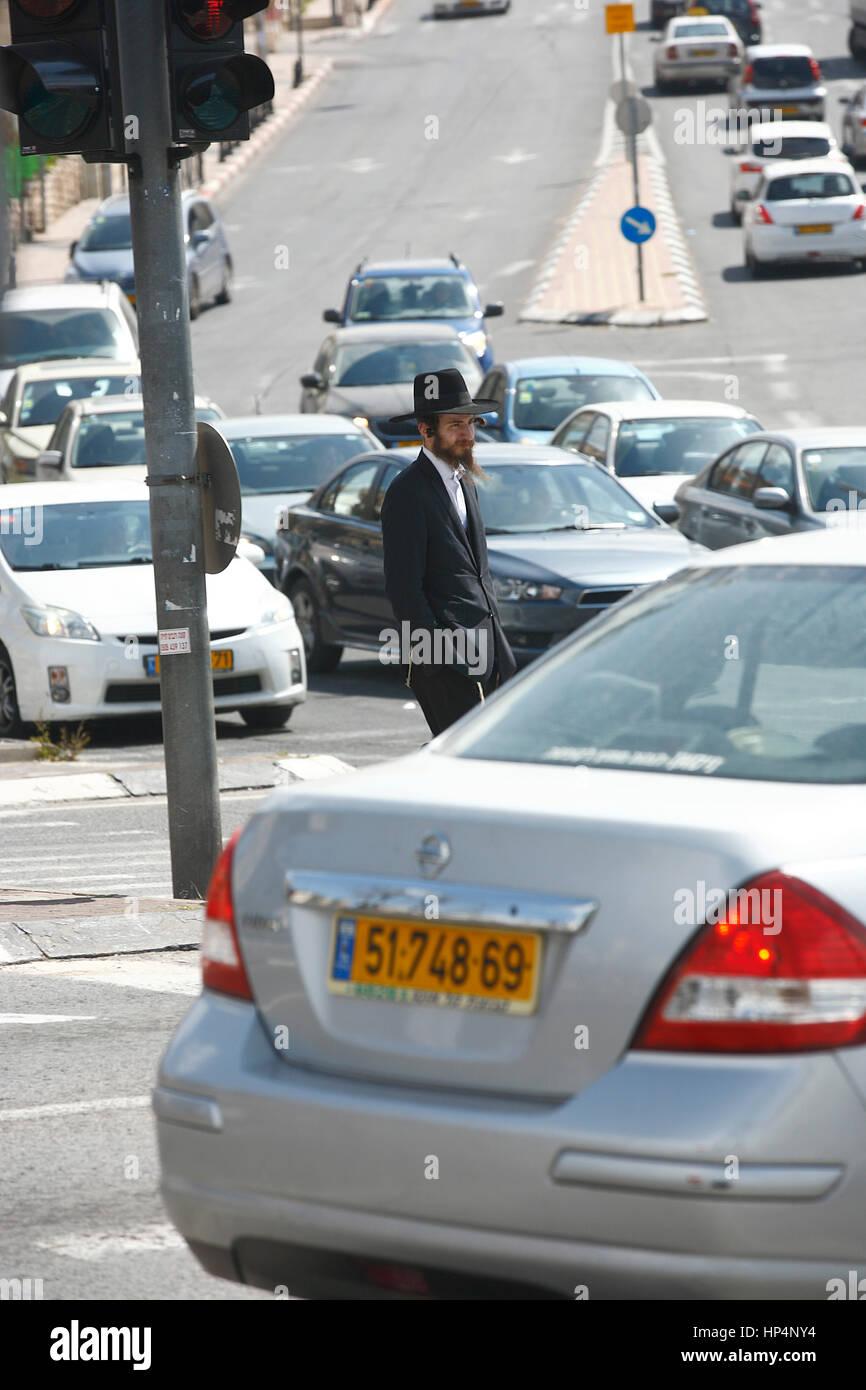 ultra-orthodox jewish man waiting at traffic lights, jerusalem, israel Stock Photo