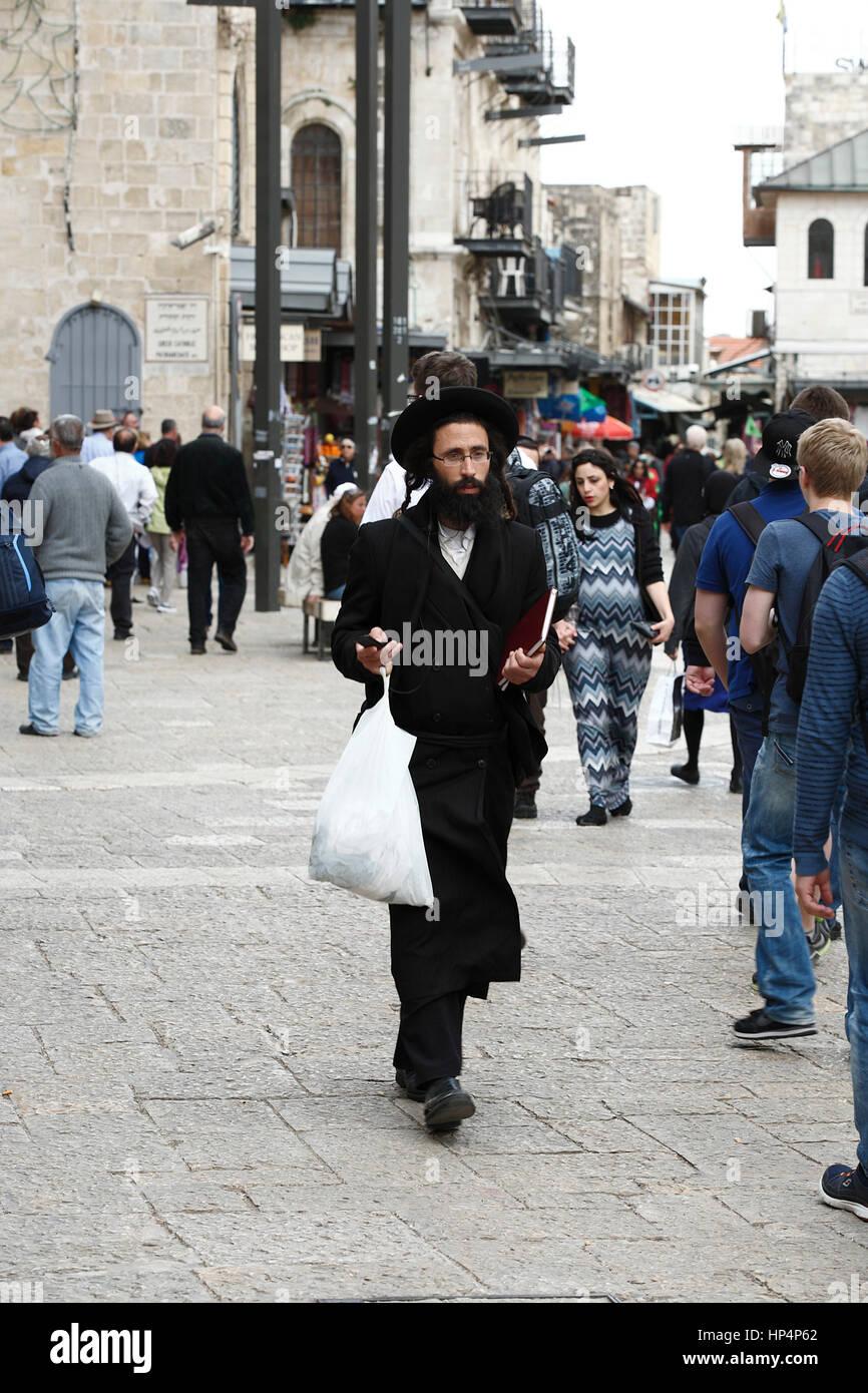 ultra-orthodox jew walking at jaffa street in western part of jerusalem, israel - Stock Image