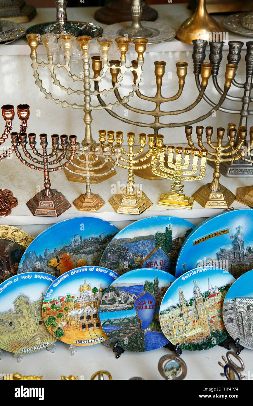 Menorah replica and painted decorative wall plates in a gift shops window, old city, jerusalem, israel Stock Photo